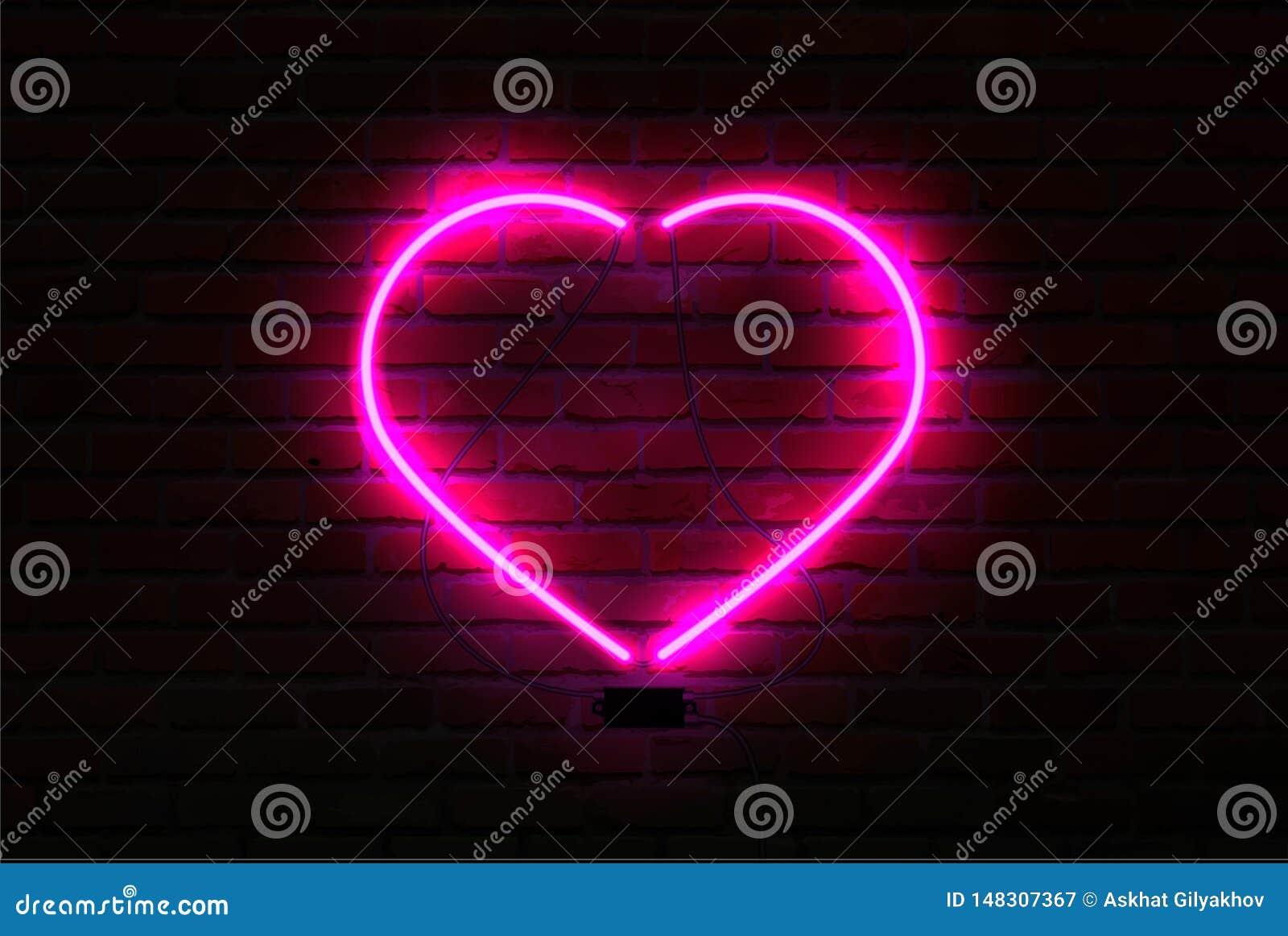 在砖墙背景的桃红色发光的霓虹心脏