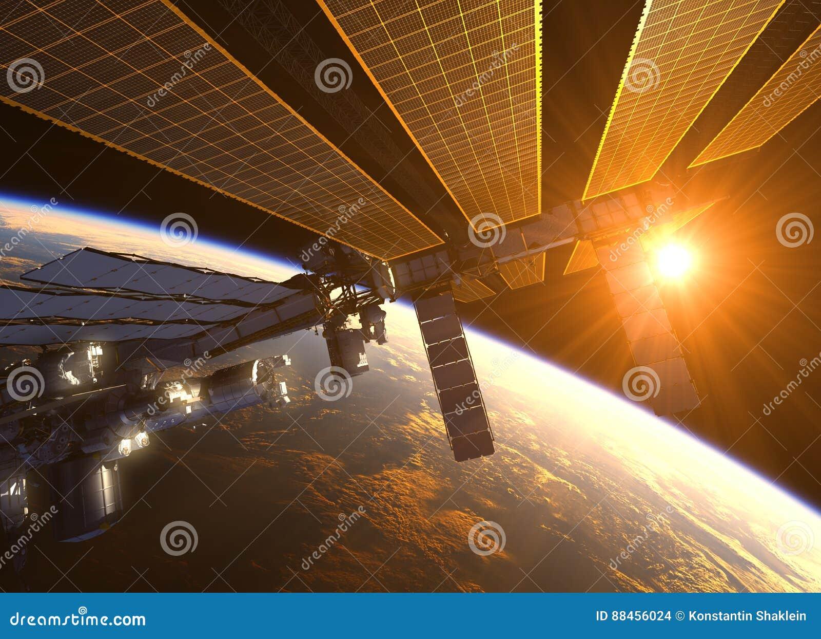 在红色太阳光芒的国际空间站