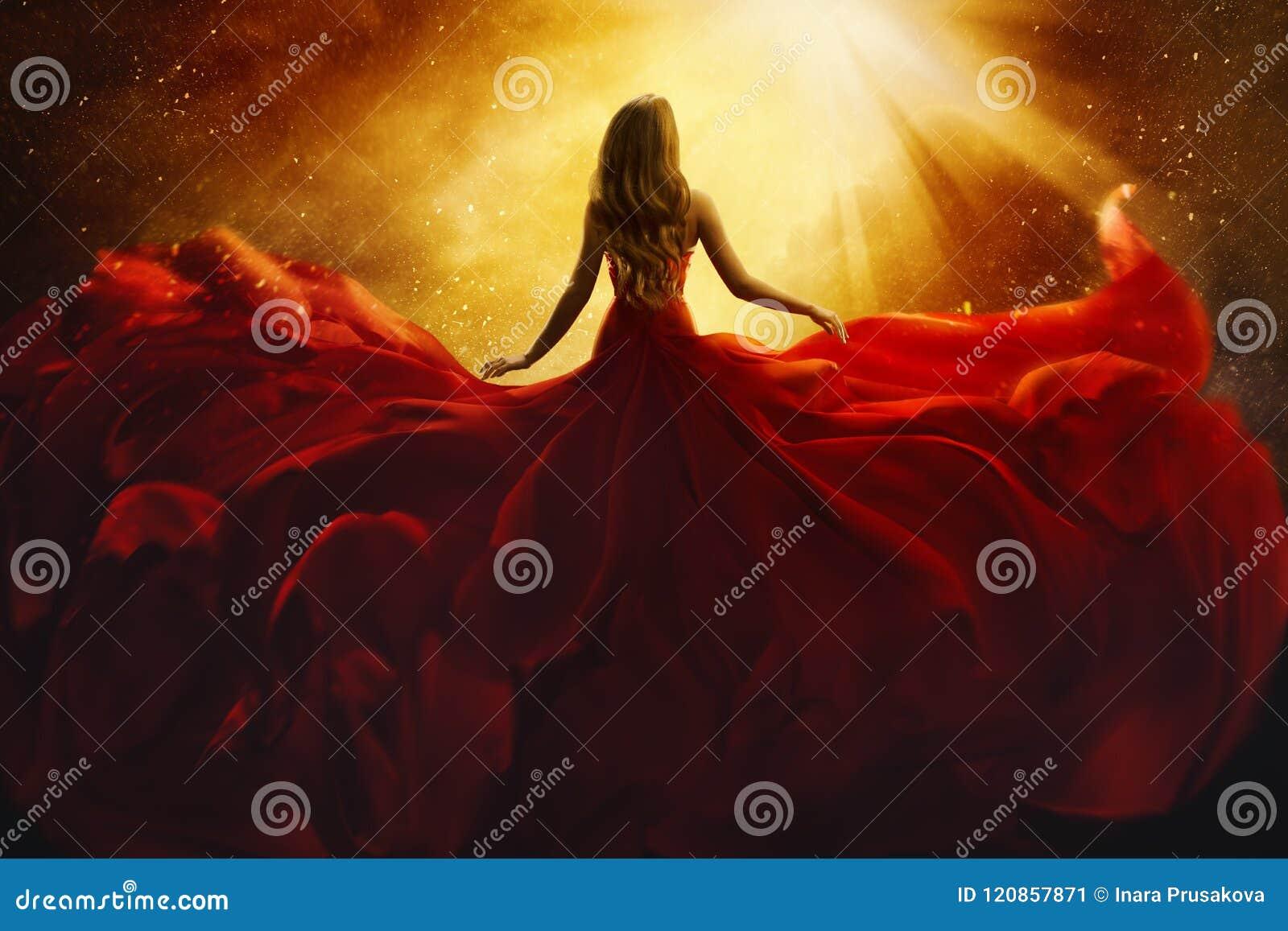 在红色飞行礼服的时装模特儿后部,妇女背面图