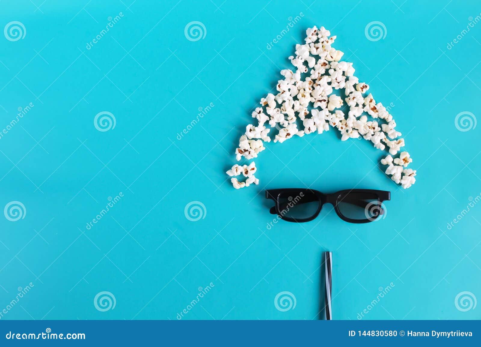在蓝纸背景的戏院时间 观察者,3D玻璃,玉米花的抽象乐趣图象 E