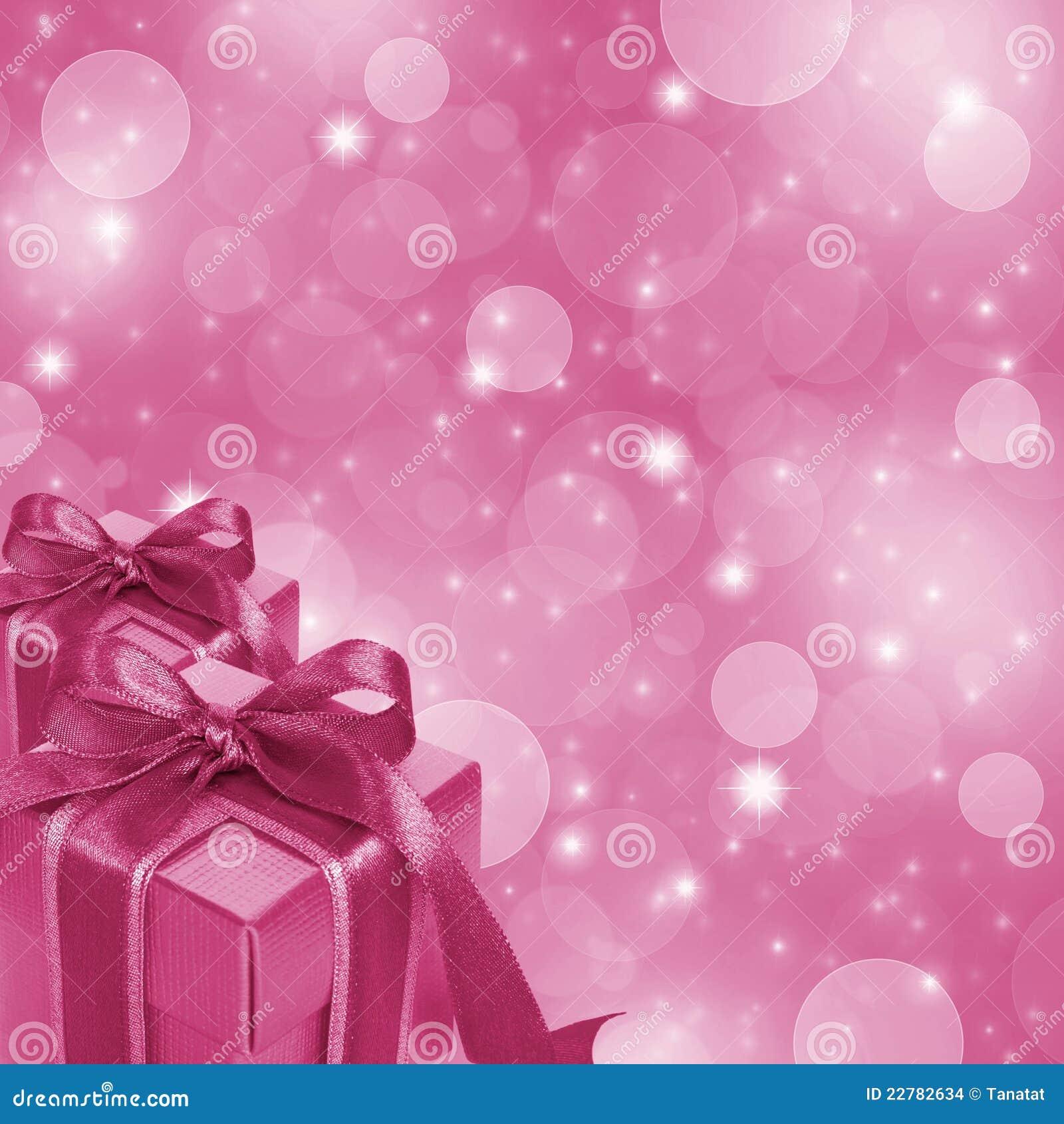 在闪烁背景的桃红色礼物盒