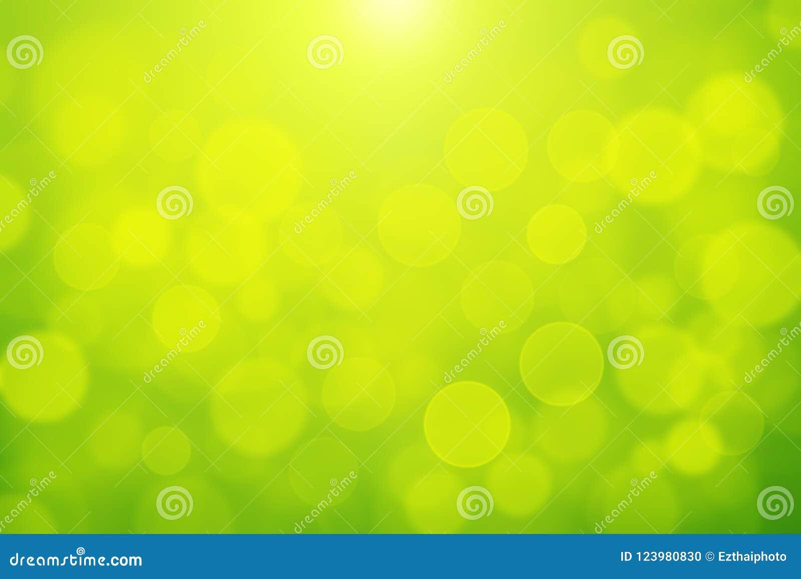在黄色和绿色背景的绿色bokeh摘要光背景blurly白色bokeh