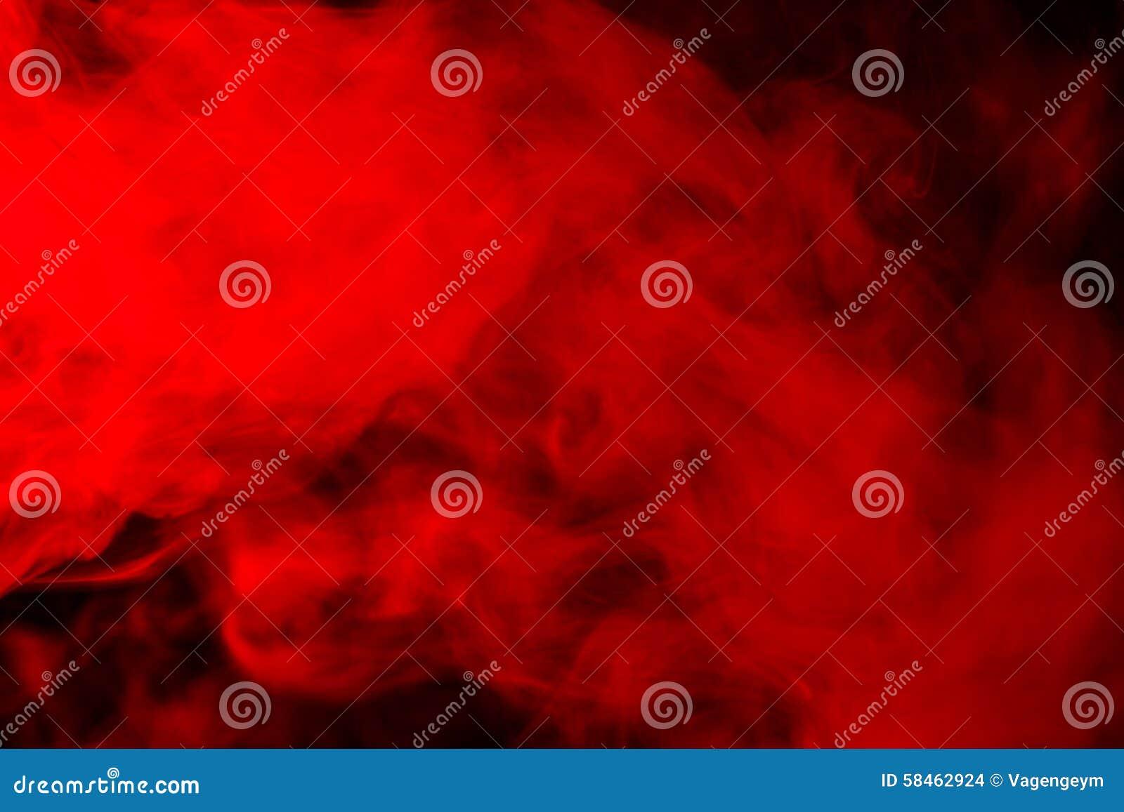在黑背景的抽象红橙色烟水烟筒