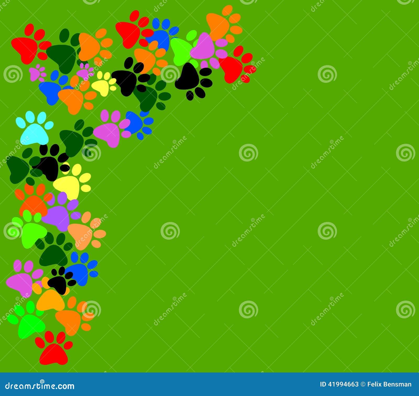 在绿色背景的色的pawprints