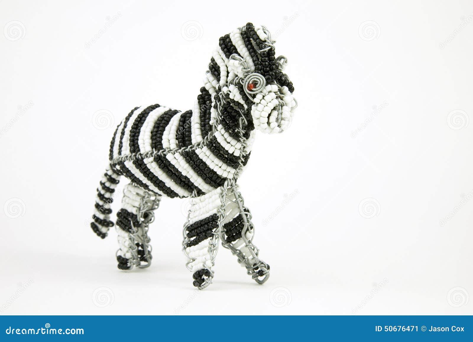 Download 在w隔绝的斑马的架线的和成串珠状的非洲动物工艺 库存图片. 图片 包括有 背包, 架线, 敌意, 闹事, 空间 - 50676471