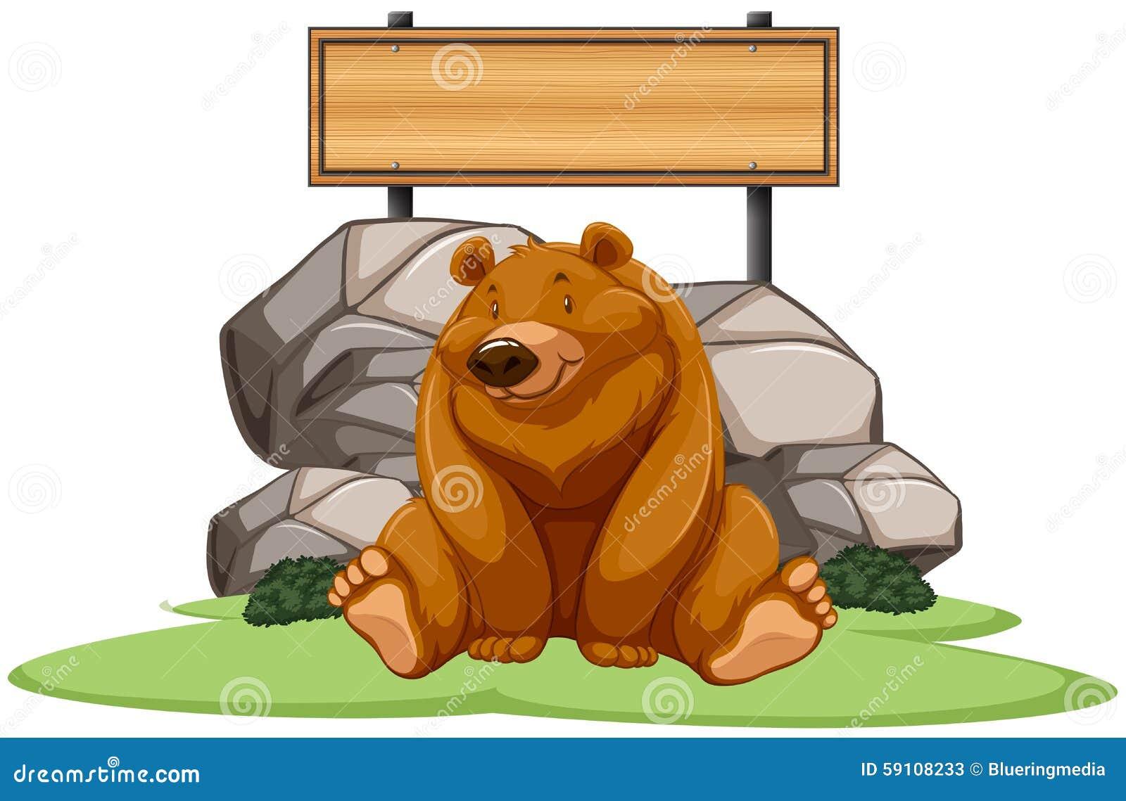 坐在标志旁边的北美灰熊