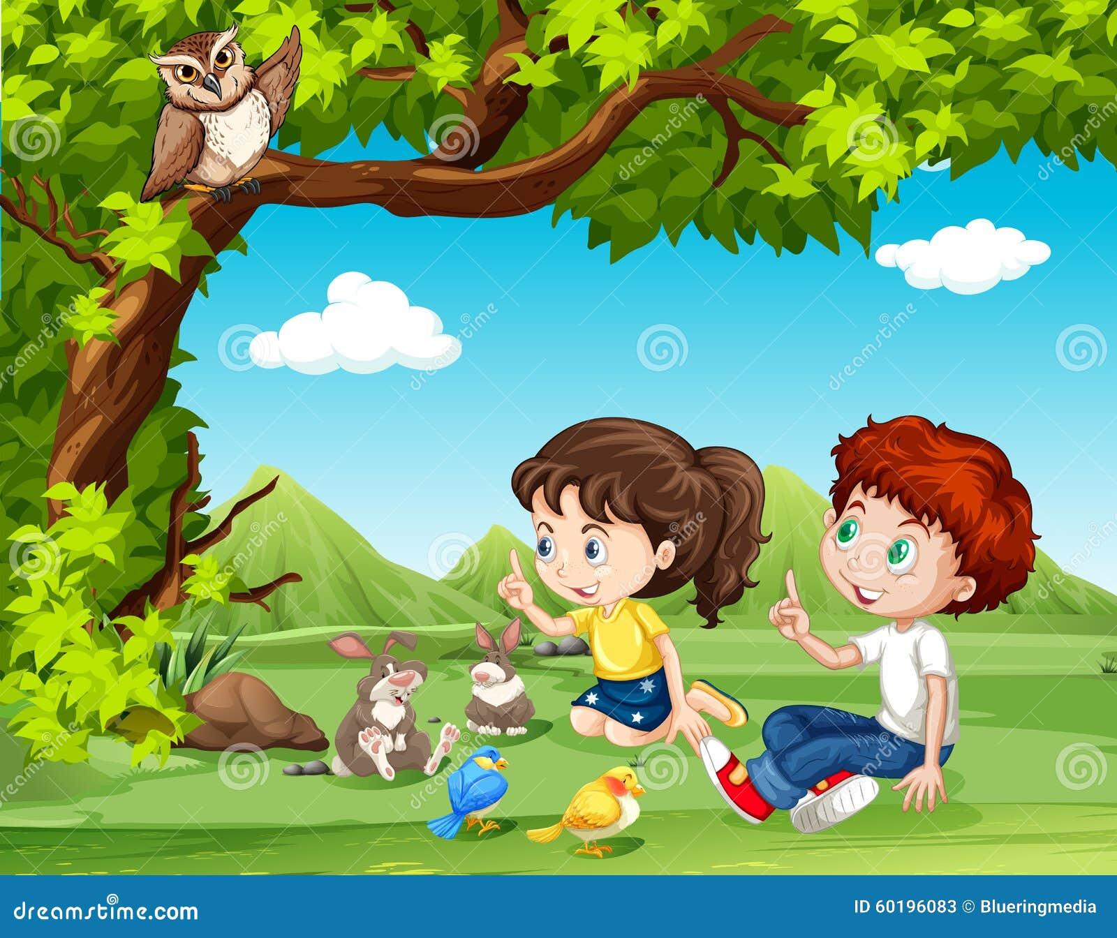 坐在树下的男孩和女孩