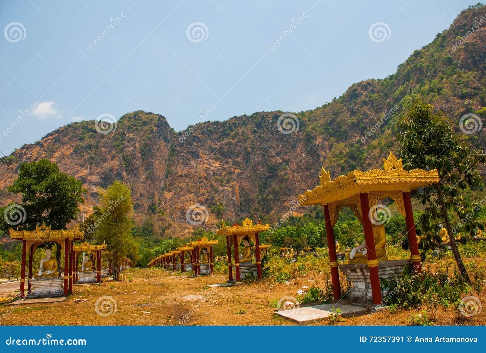坐Buddhas的许多雕象,在与山的美好的风景中在晴天 Hpa-An,缅甸 缅甸