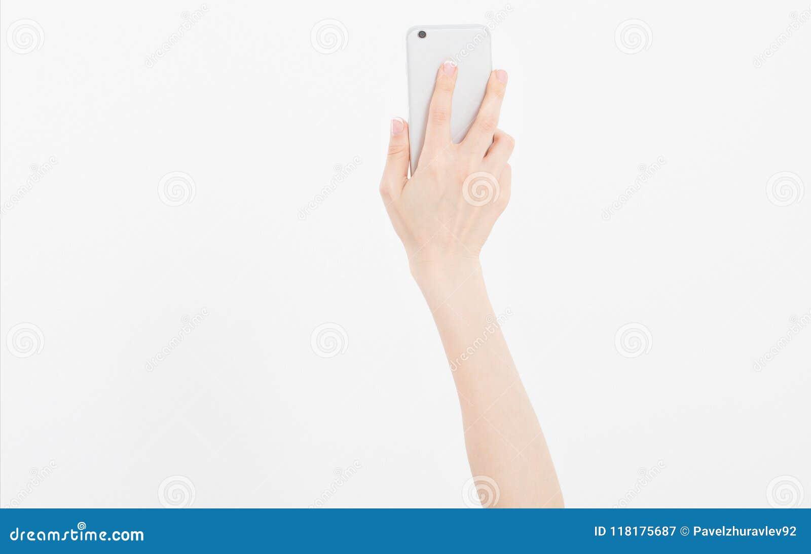 基辅,乌克兰, 06 01 2018年:iphone 6 苹果小配件 递拿着黑电话被隔绝在白色裁减路线里面 顶视图 嘲笑