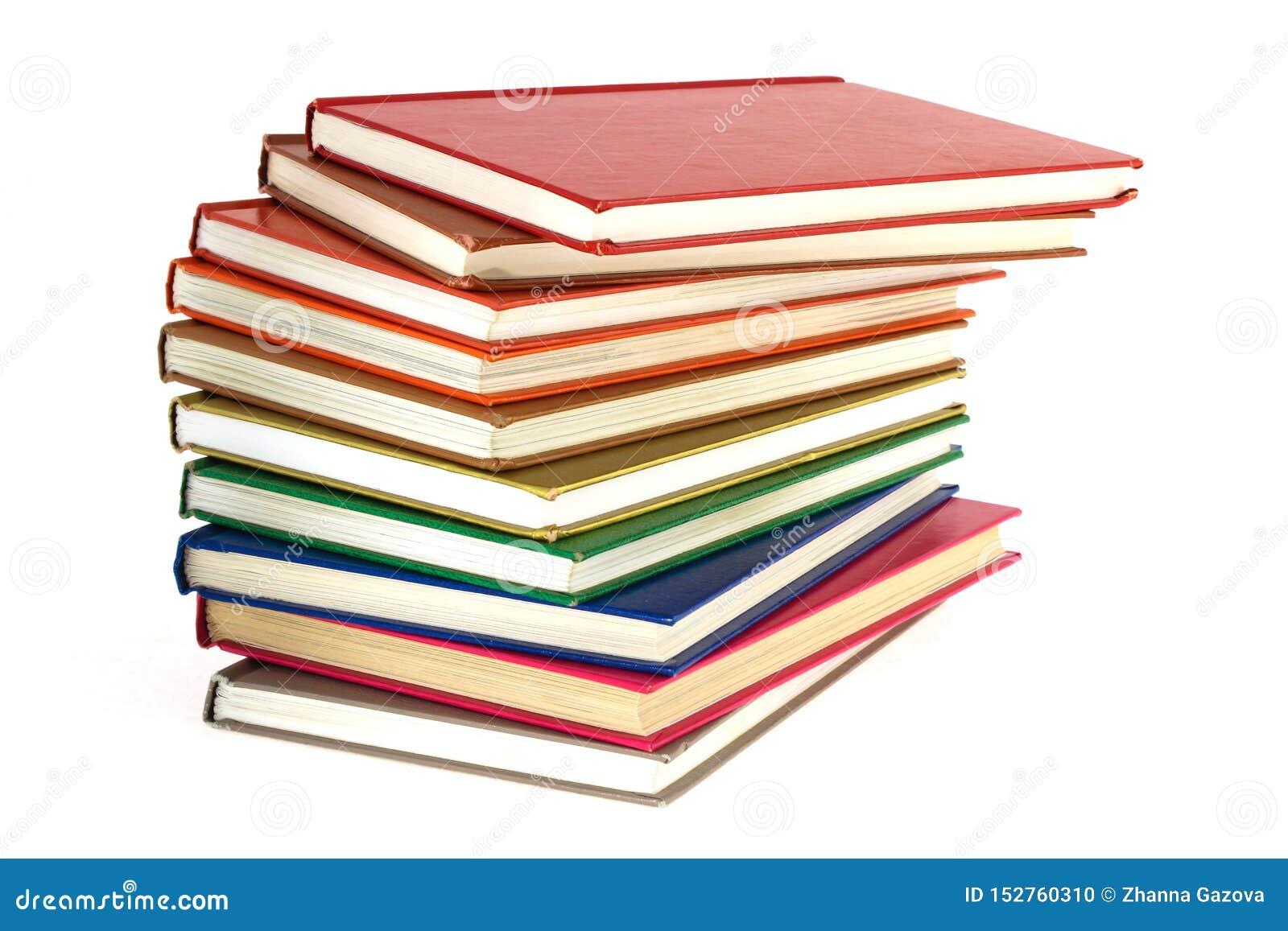 堆在白色背景的多彩多姿的书