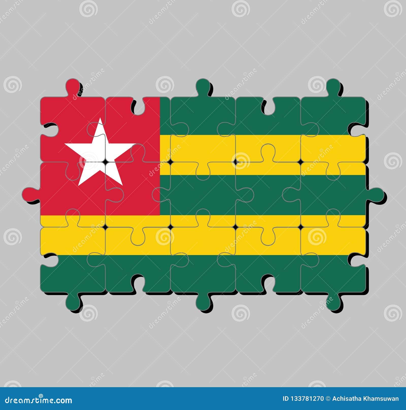 多哥旗子拼图在交替与黄色的绿色五条相等的水平的带的;当一个红色小行政区负担一个白色星