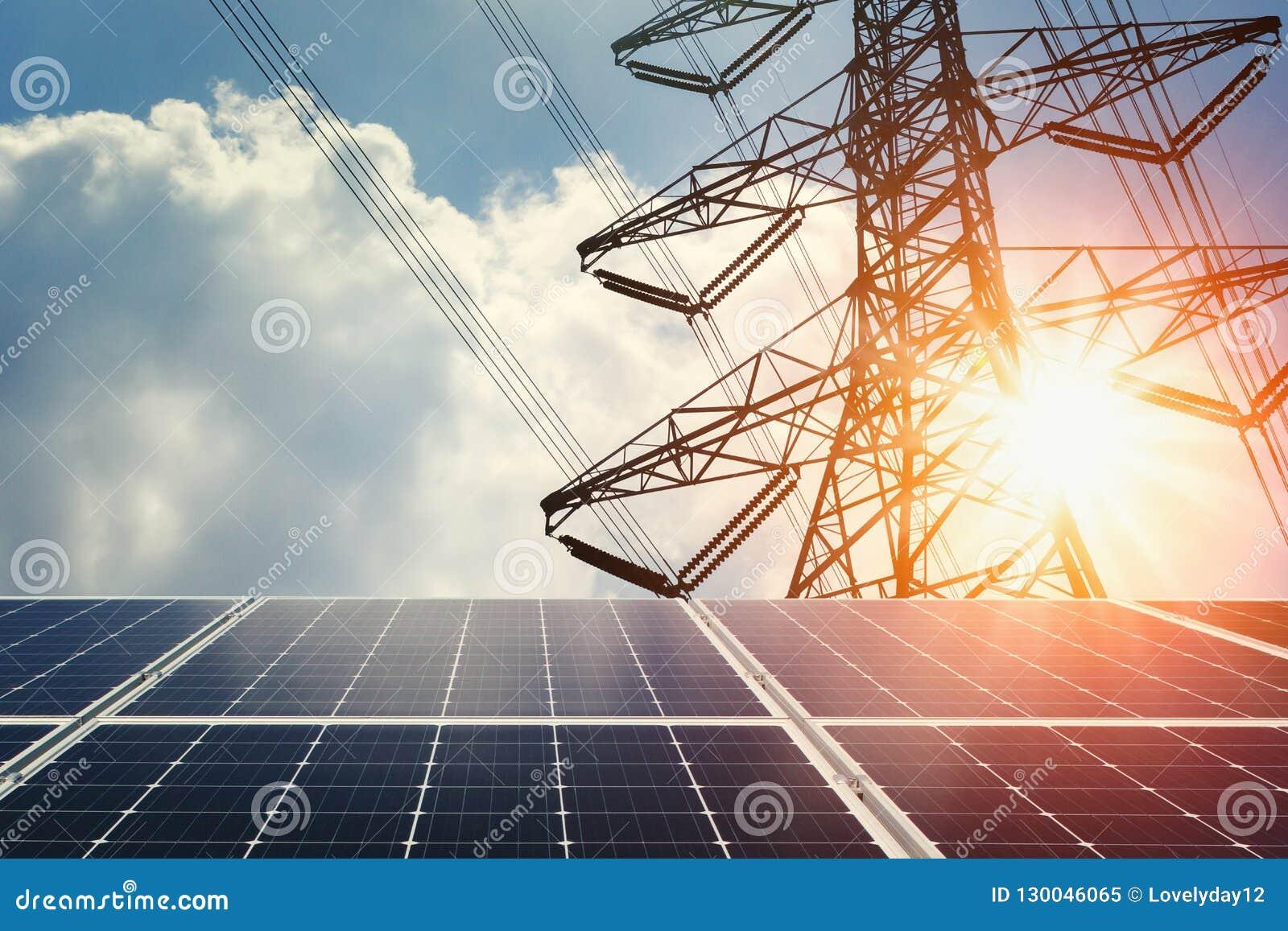太阳电池板和高压塔与阳光 清洁能源p
