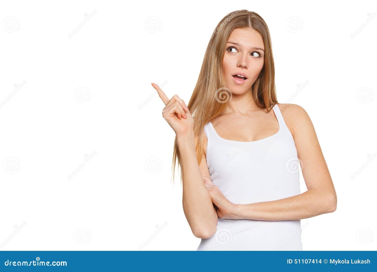 兴奋的美丽的惊奇的妇女指向边的 查出在白色