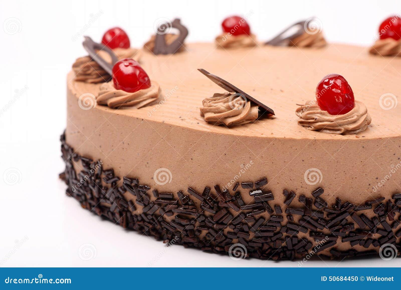 Download 奶油色可可粉蛋糕用在白色背景的樱桃 库存照片. 图片 包括有 背包, 可可粉, 厨师, 烘烤, 咖啡, 果仁巧克力 - 50684450