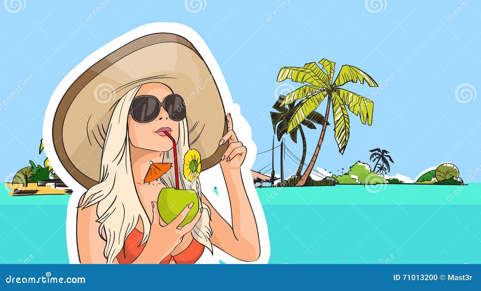 妇女帽子太阳镜饮料椰子鸡尾酒海滩热带海岛图片