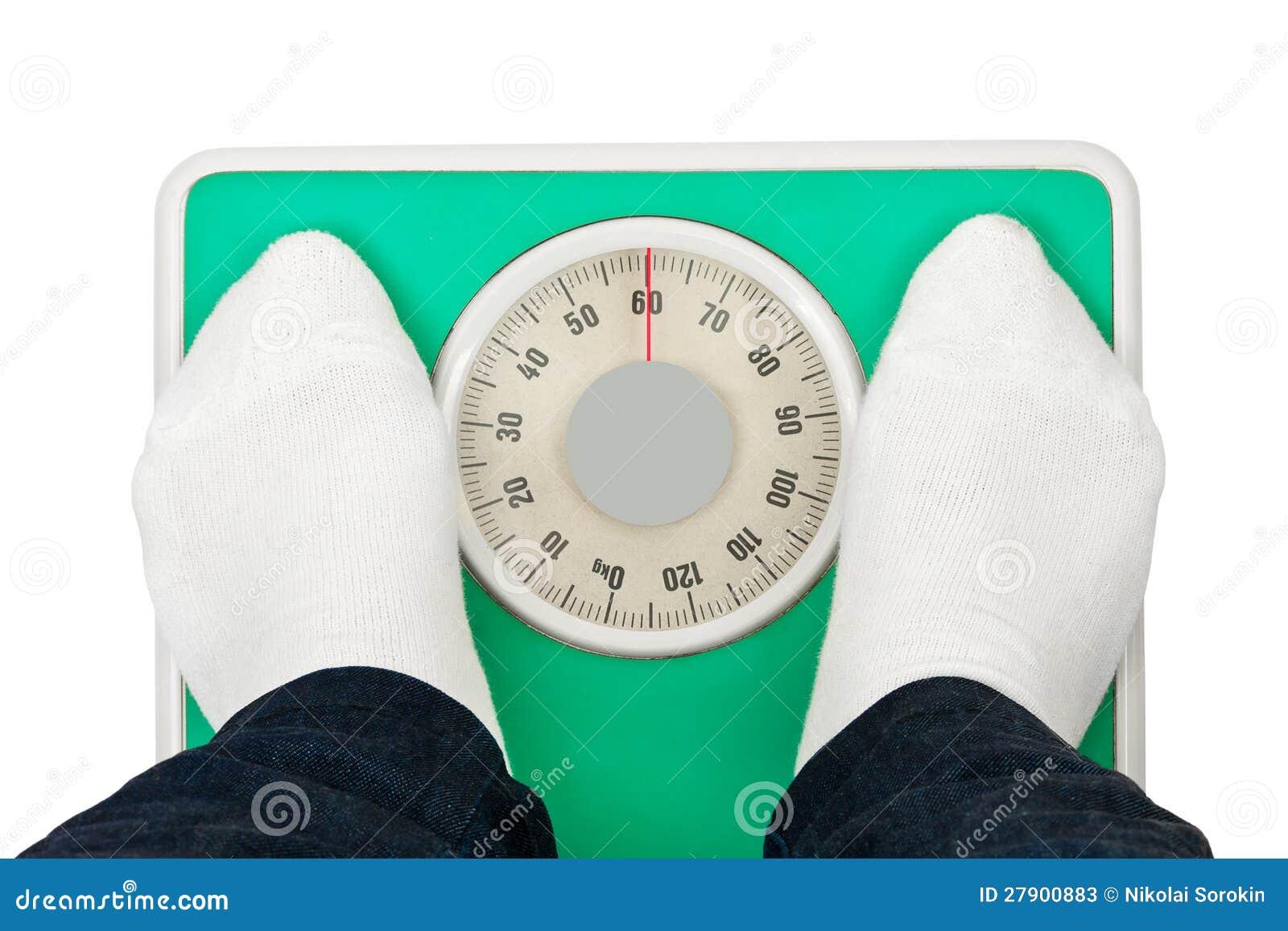 妇女英尺和重量缩放比例