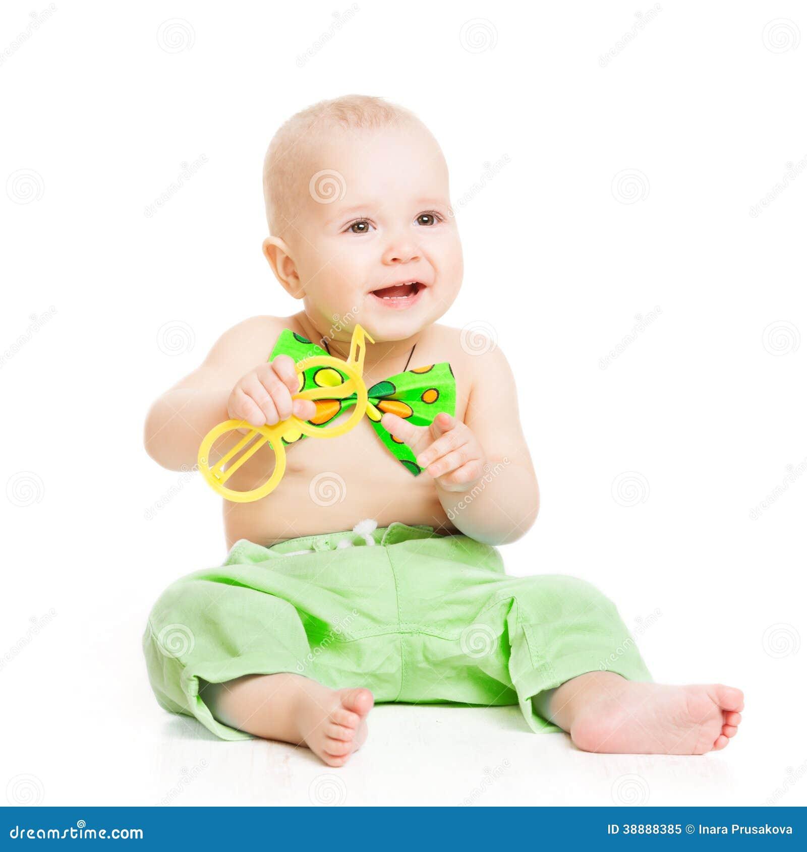 婴孩愉快微笑,绿色蝶形领结的smal孩子男孩