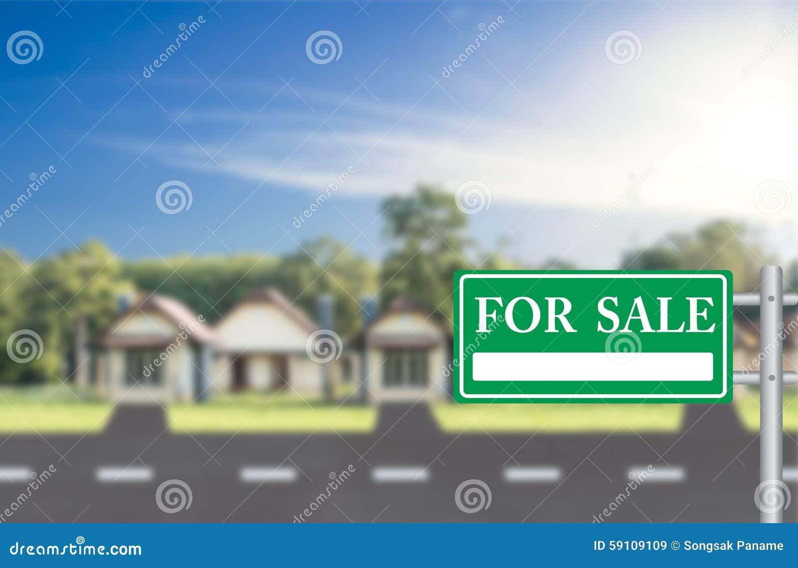 家与绿色的待售待售标志