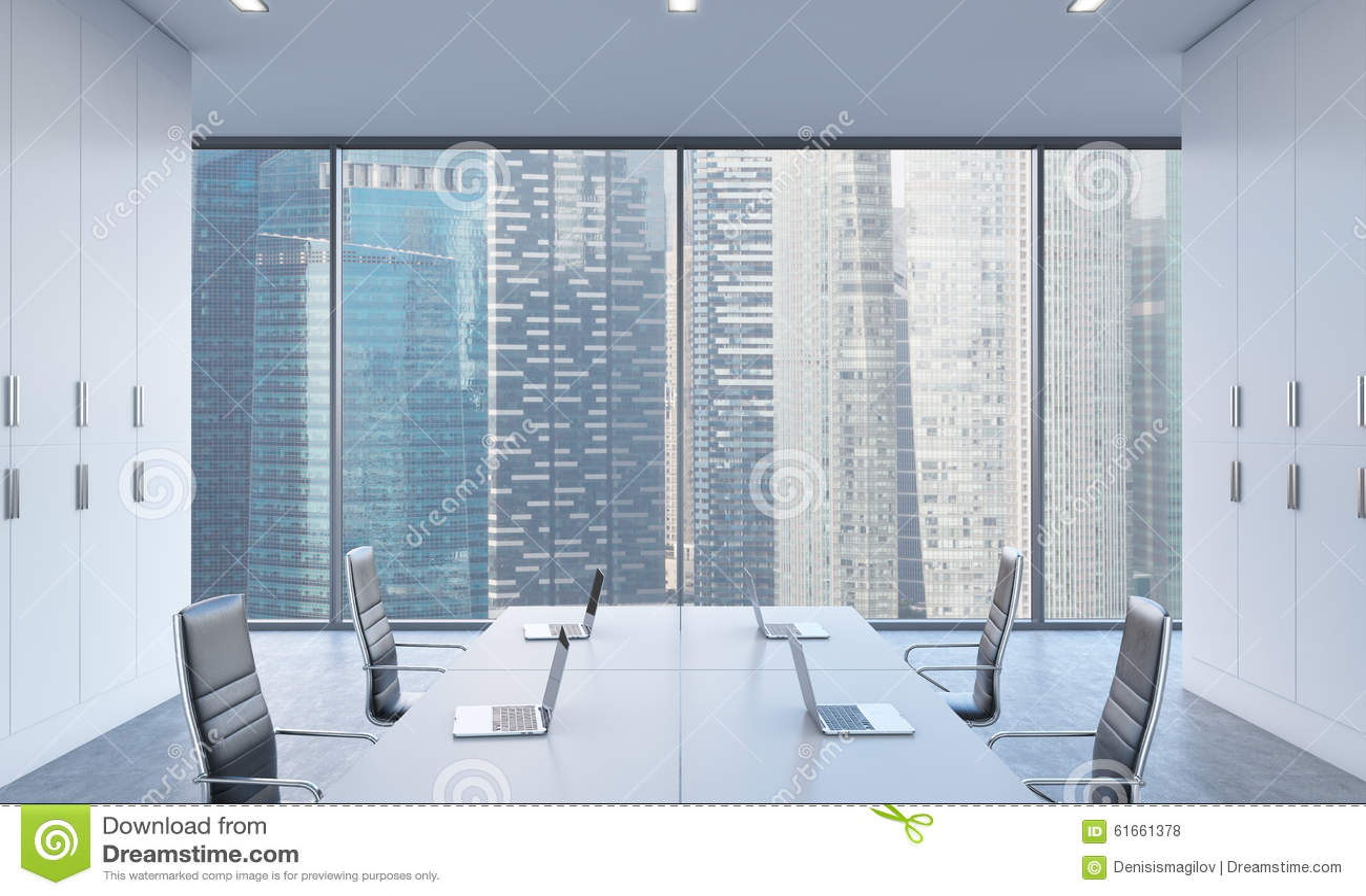 工作场所或会议区域在一个明亮的现代露天场所办公室 现代膝上型计算机和黑椅子装备的白色桌 唱歌