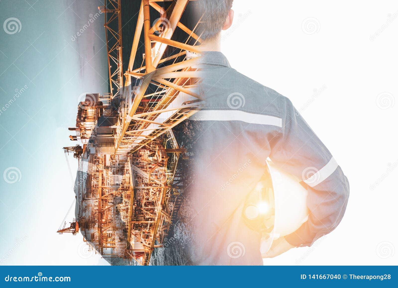 工程师或技术员人两次曝光有安全帽被管理的平台或植物的通过使用有近海油的片剂和