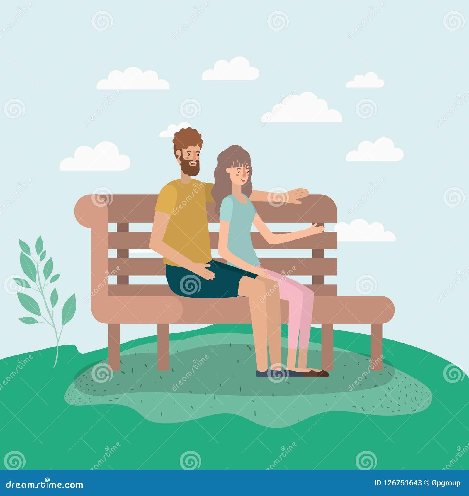 年轻夫妇恋人坐公园椅子