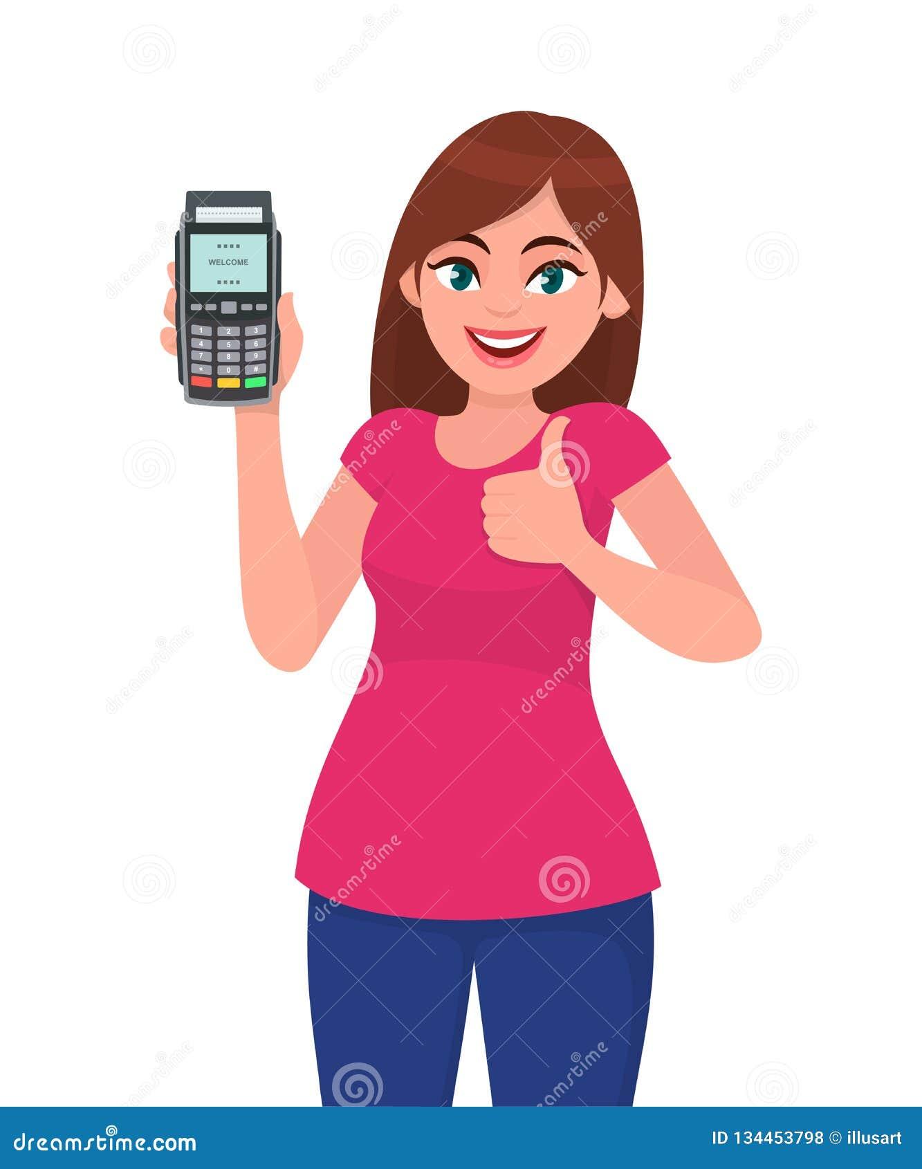 年轻女人陈列/藏品pos猛击机器的付款终端或信用/借记卡,打手势赞许标志