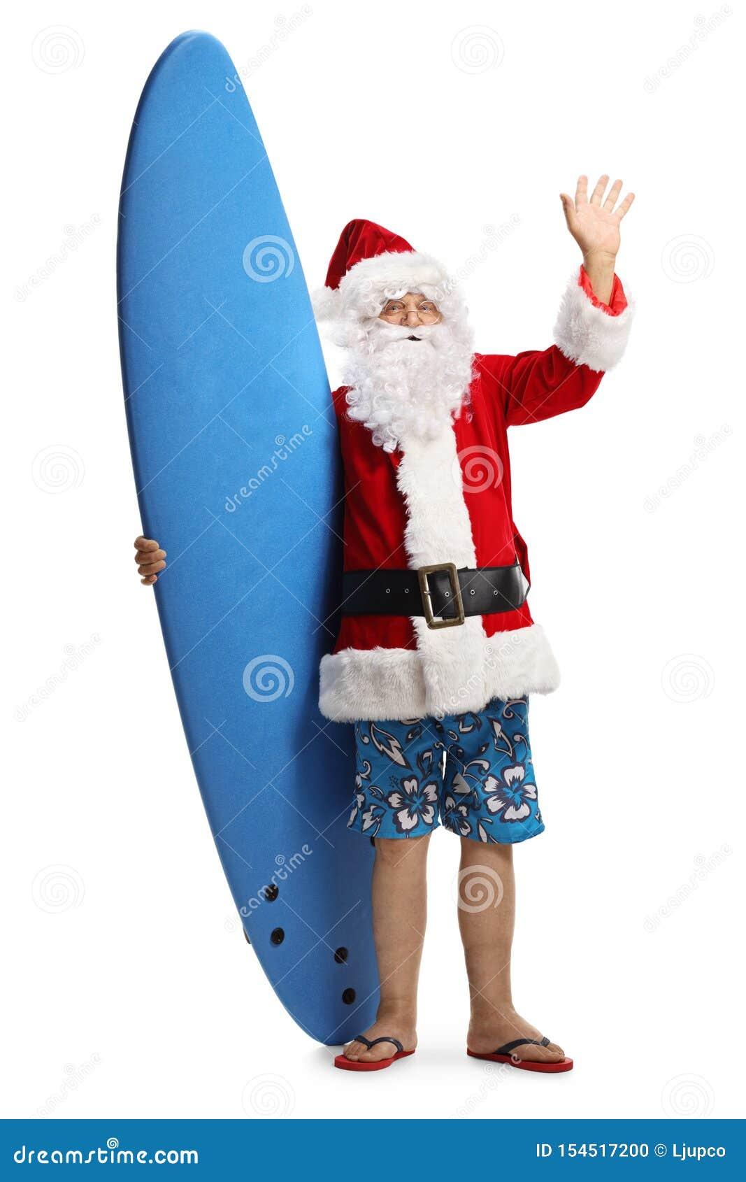 愉快的圣诞老人项目与挥动在照相机的冲浪板的一个假日