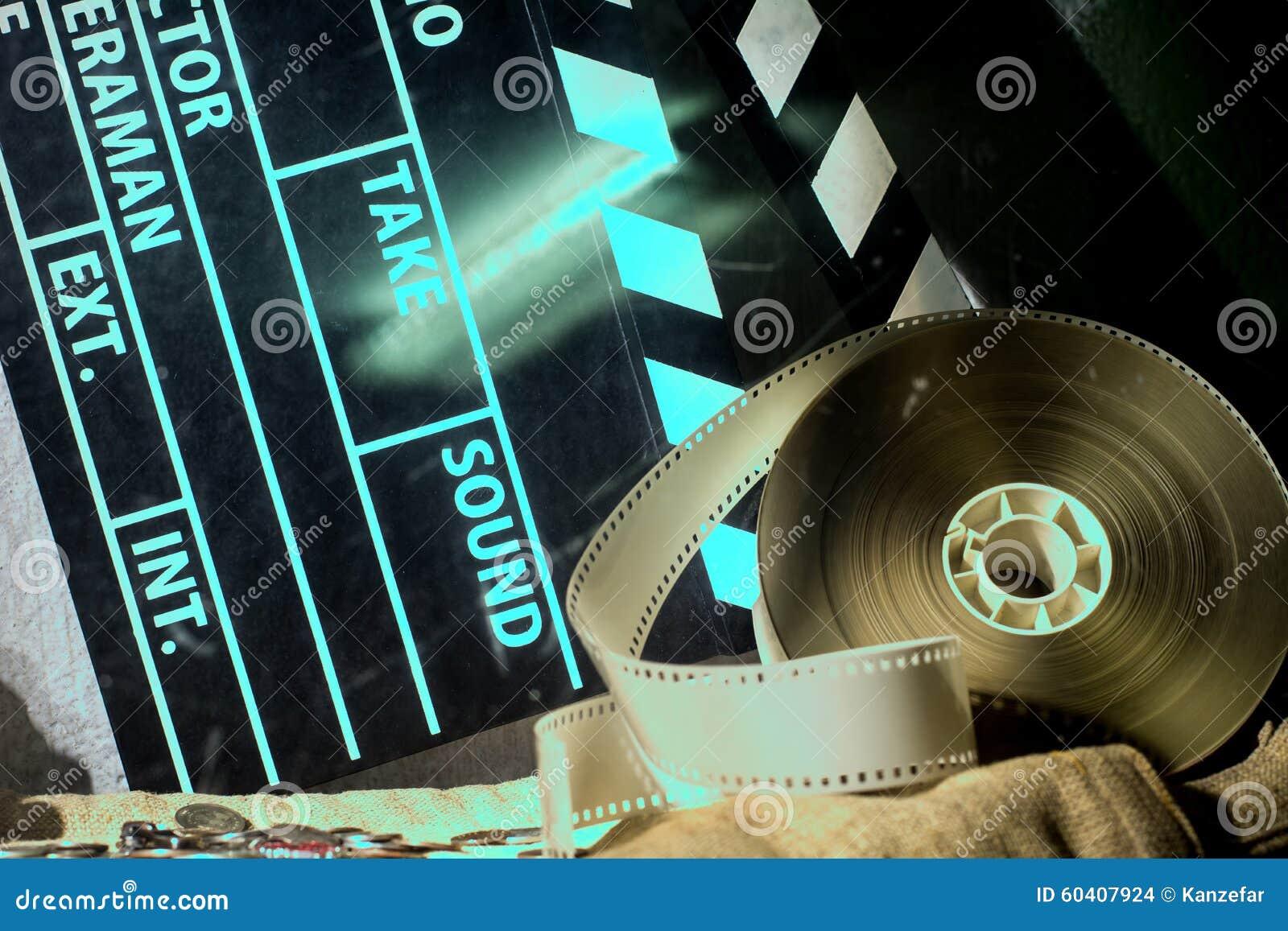 戏院拍板和录影在一块粗砺的布料的胶卷软片电影