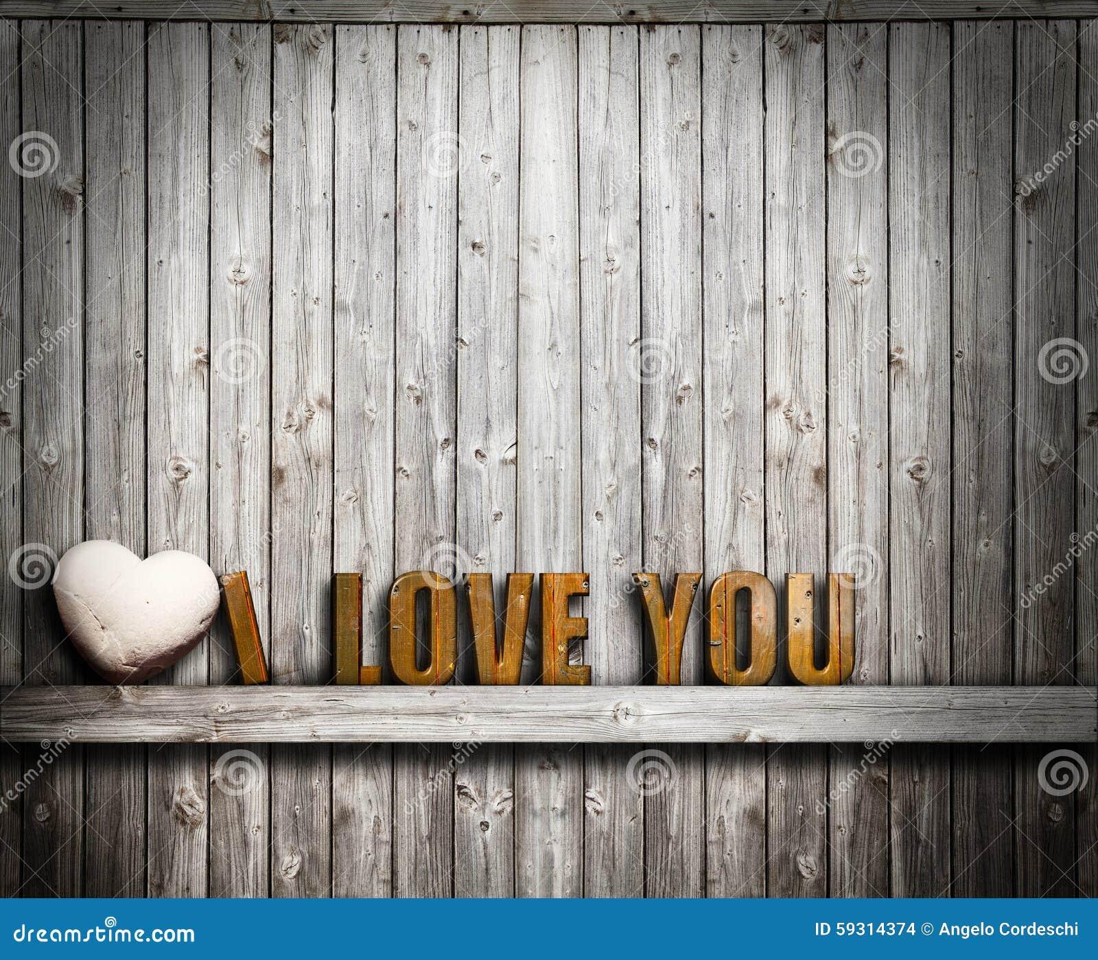 我爱你情人节 在木背景的文本和心脏石头