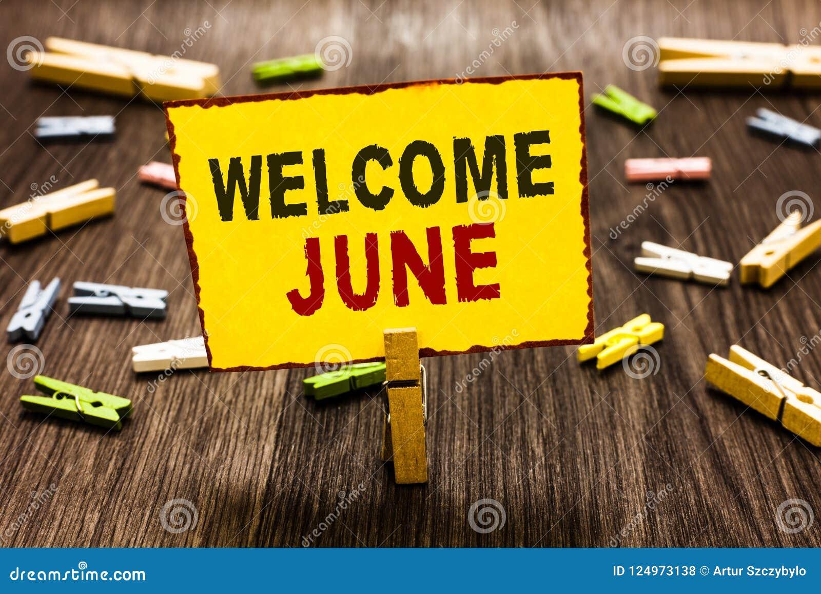 手写文本文字欢迎6月 概念意思日历第六个月二季度三十几天问候晒衣夹holdin