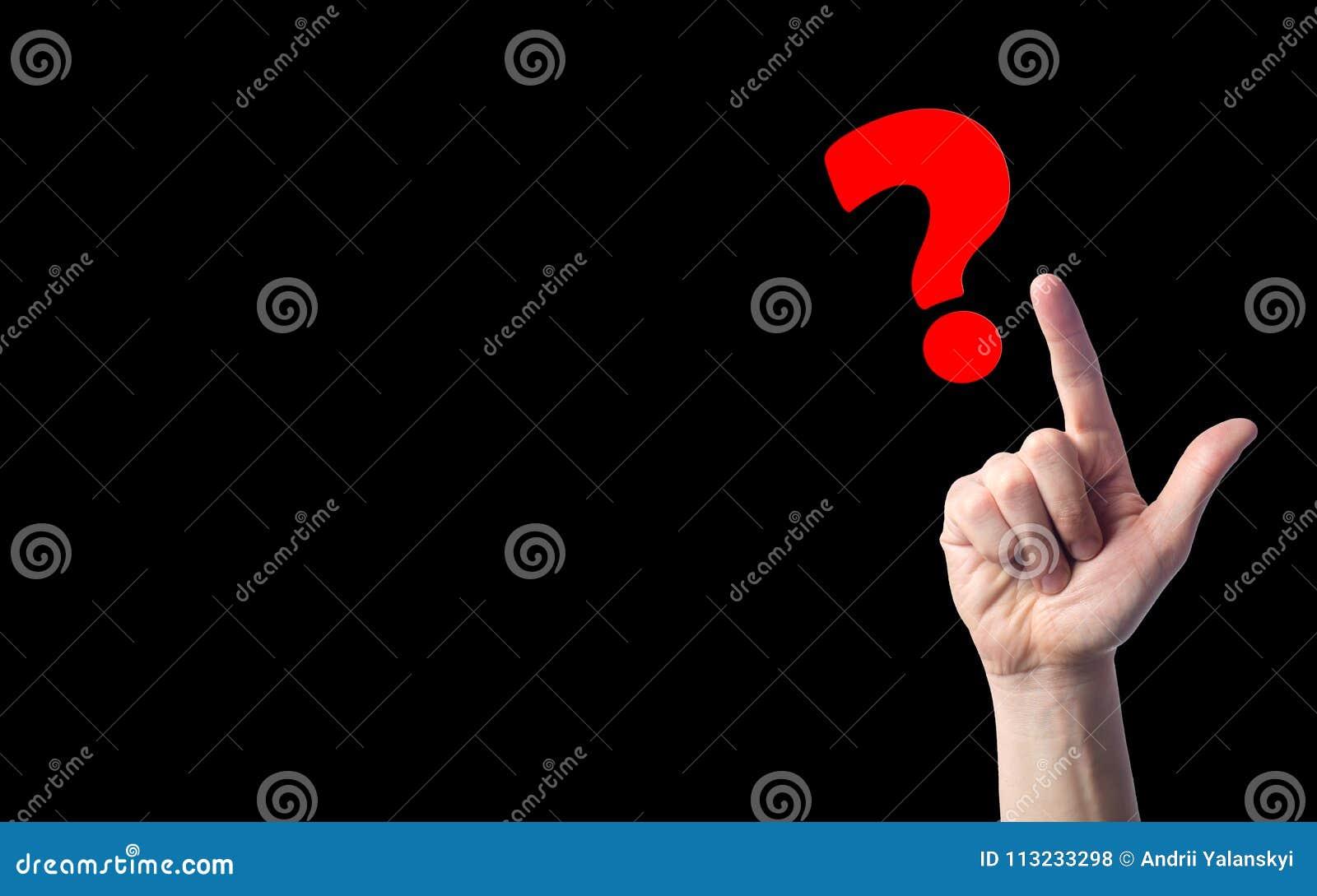 手指指向在黑色被隔绝的背景的问号 问题的概念 选择,凝思, diffic的问题