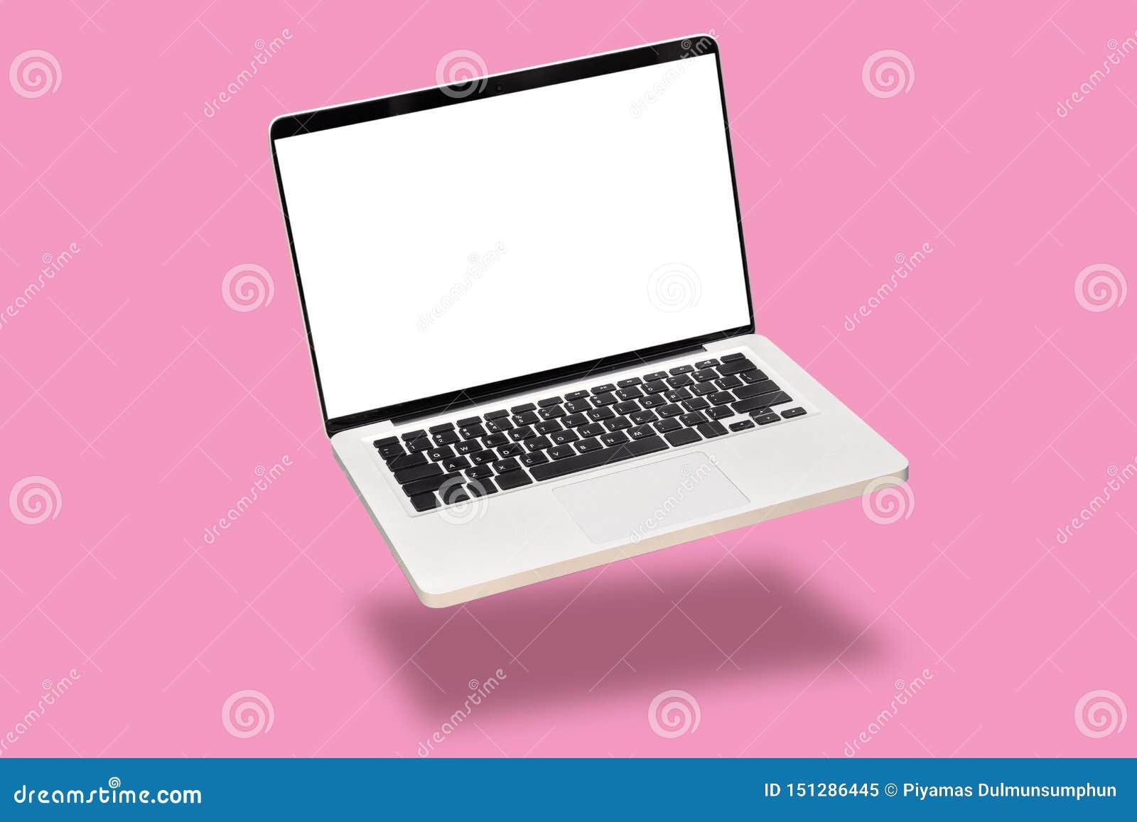 手提电脑嘲笑与在桃红色背景隔绝的空的空白的白色屏幕 漂浮或浮动有阴影的膝上型计算机笔记本