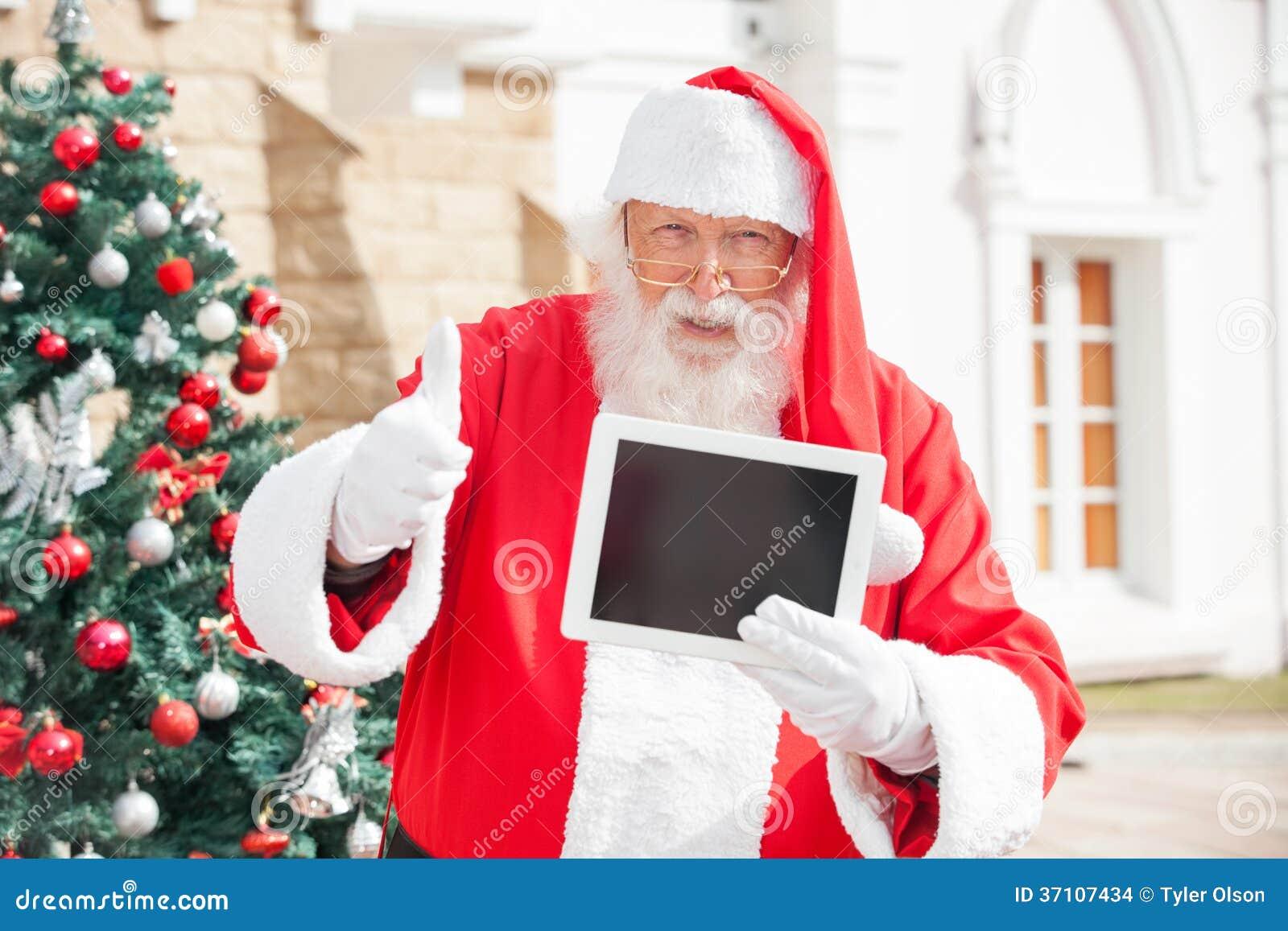 打手势Thumbsup的圣诞老人,当举行时