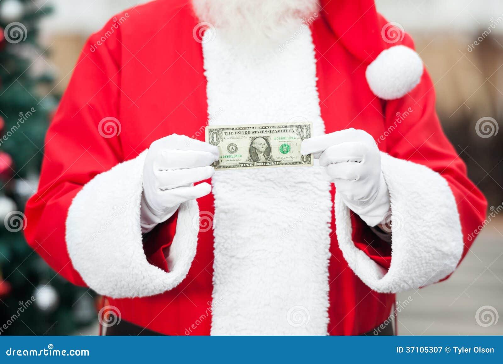 拿着一美元笔记的圣诞老人