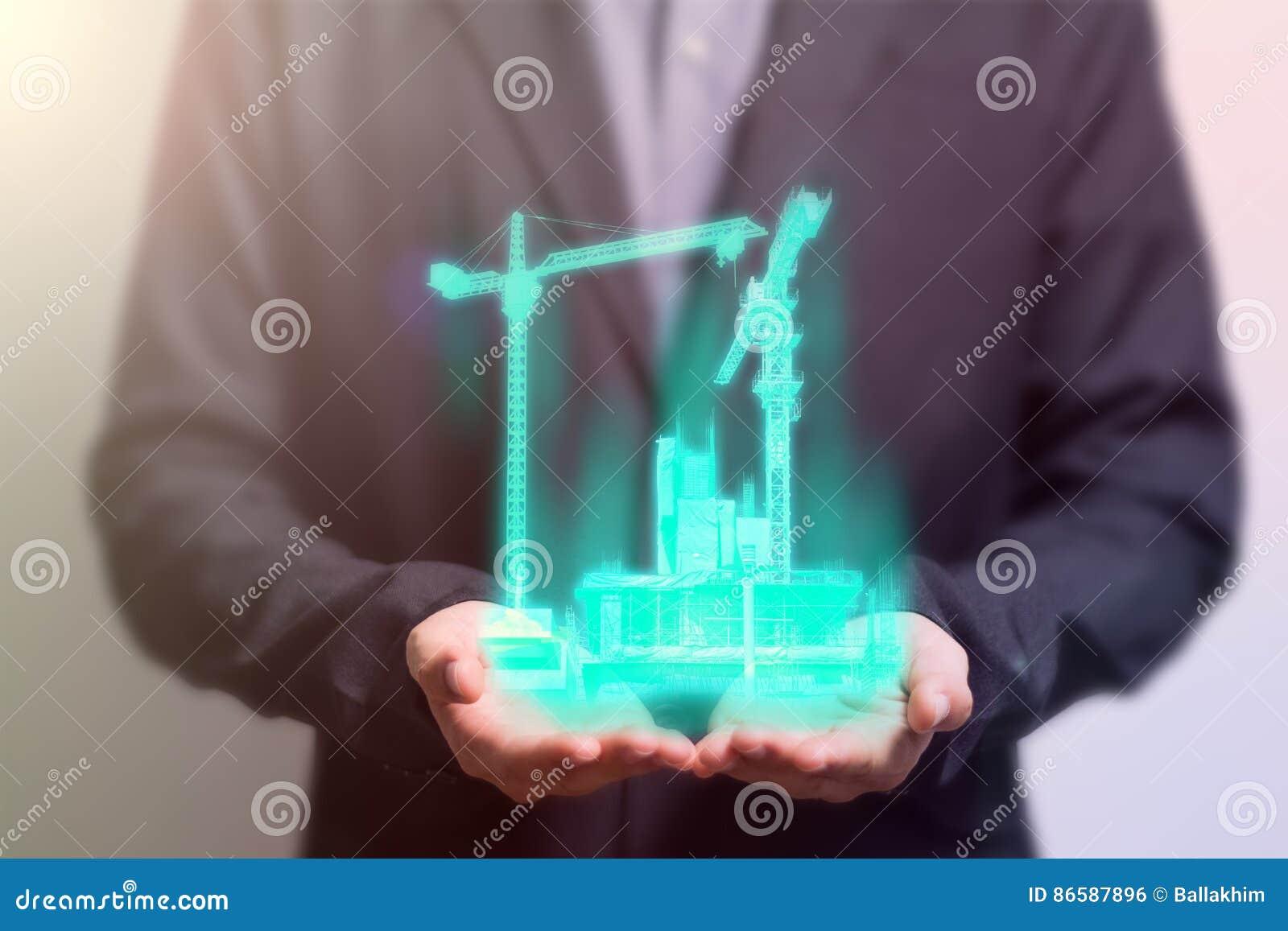 拿着全息图起重机楼房建筑的土木工程师