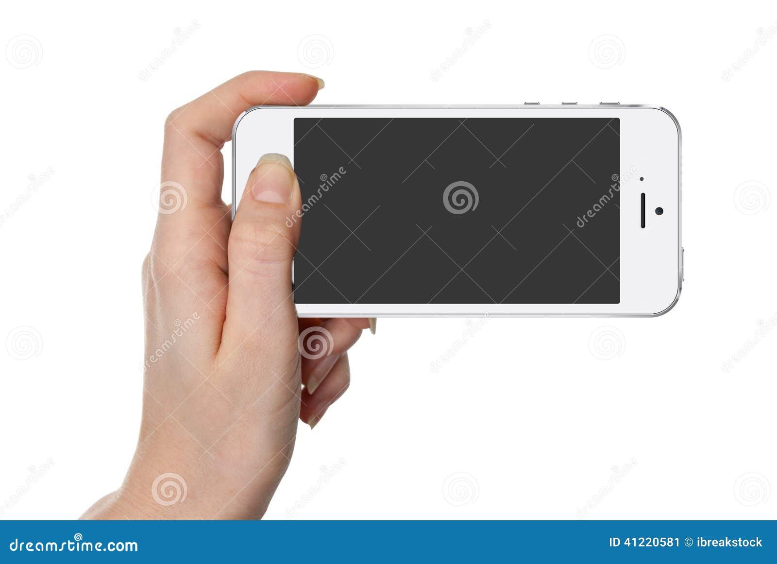 拿着有被隔绝的屏幕的妇女白色巧妙的电话手中