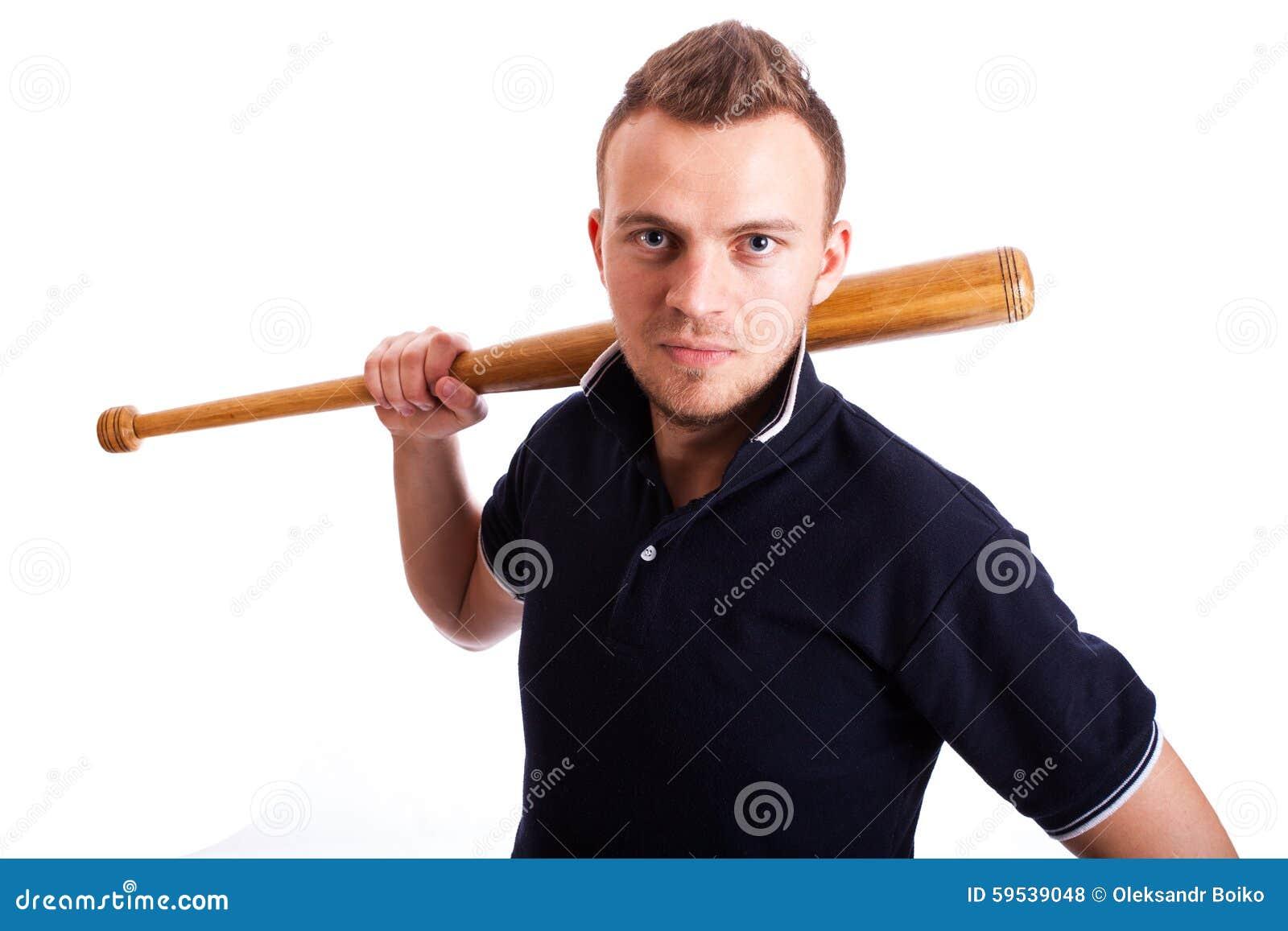 拿着棒球棒的恼怒的人手被隔绝在白色