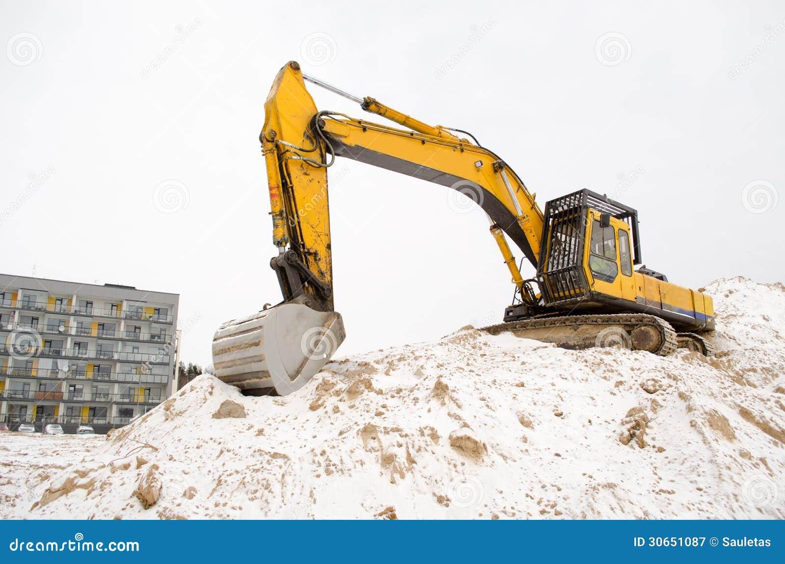 挖掘机沙坑雪冬天公寓