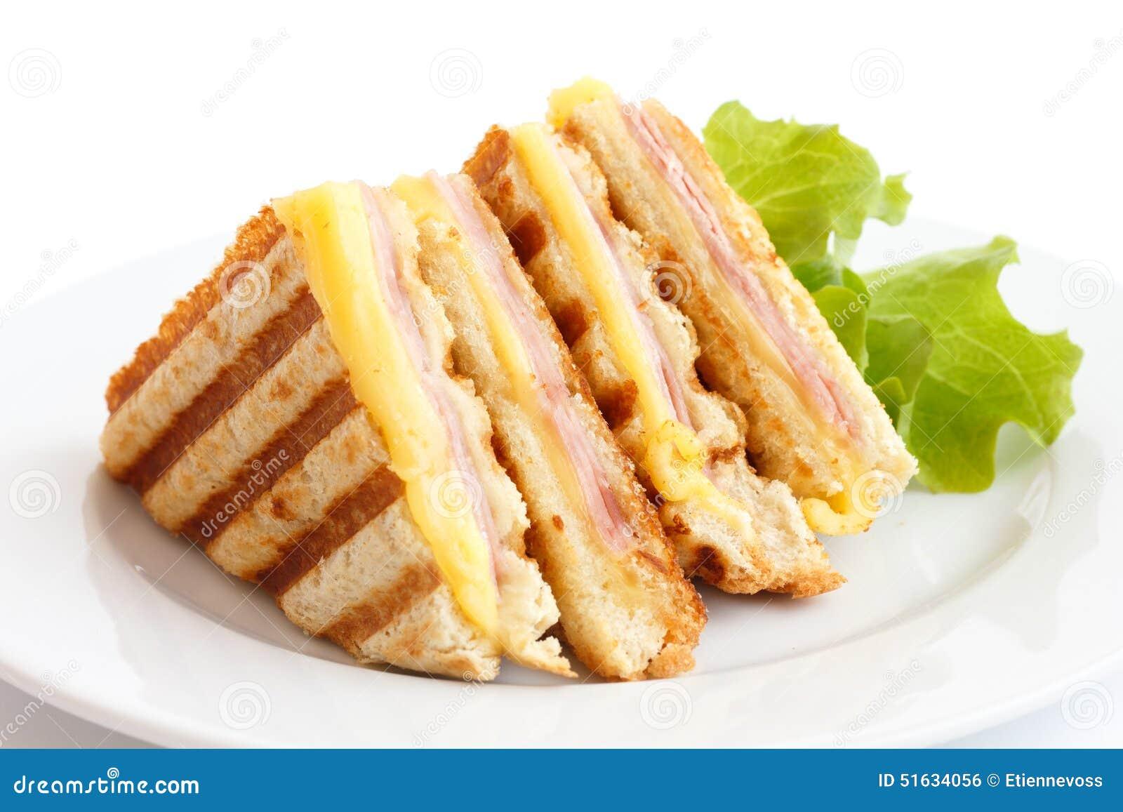 敬酒的火腿和乳酪panini