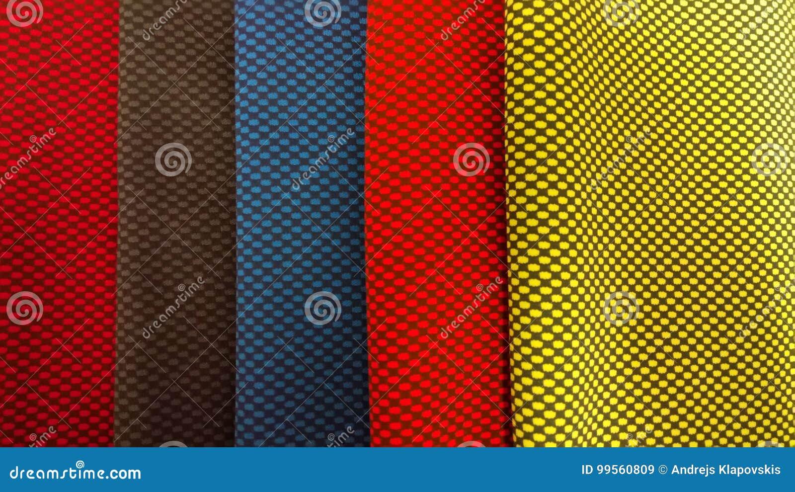 新工业黄色,橙色,灰色,蓝色和紫罗兰滚动背景 概念:材料,织品,制造,服装工厂,新