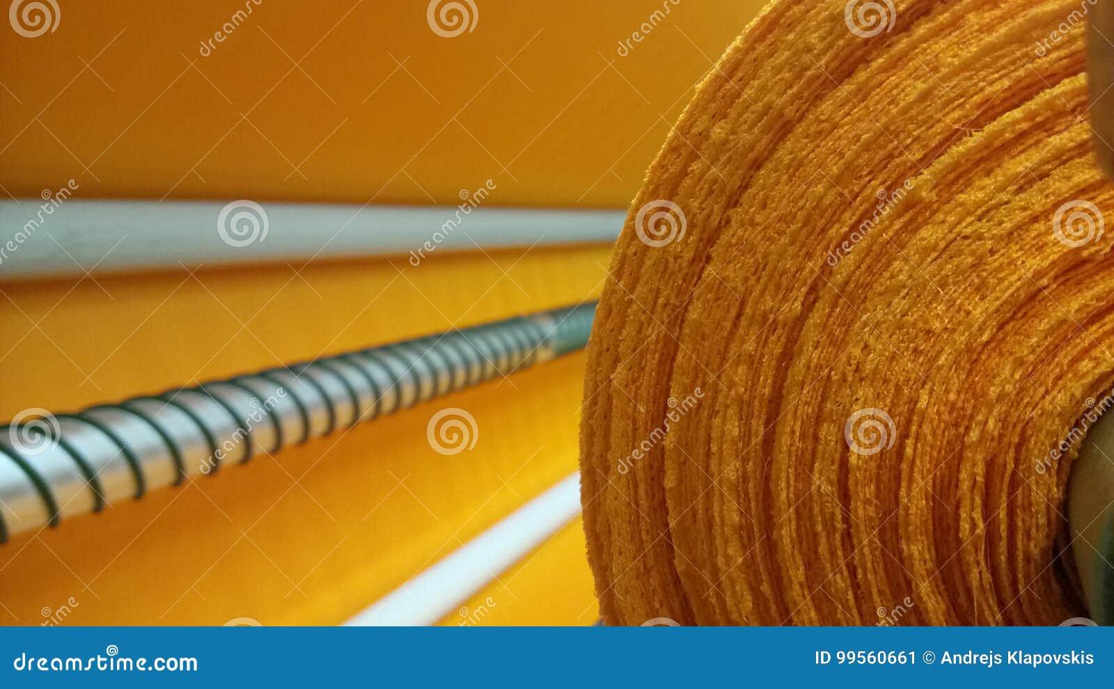 新的工业橙色卷,橙色背景 概念:材料,织品,制造,服装工厂,织品新的样品