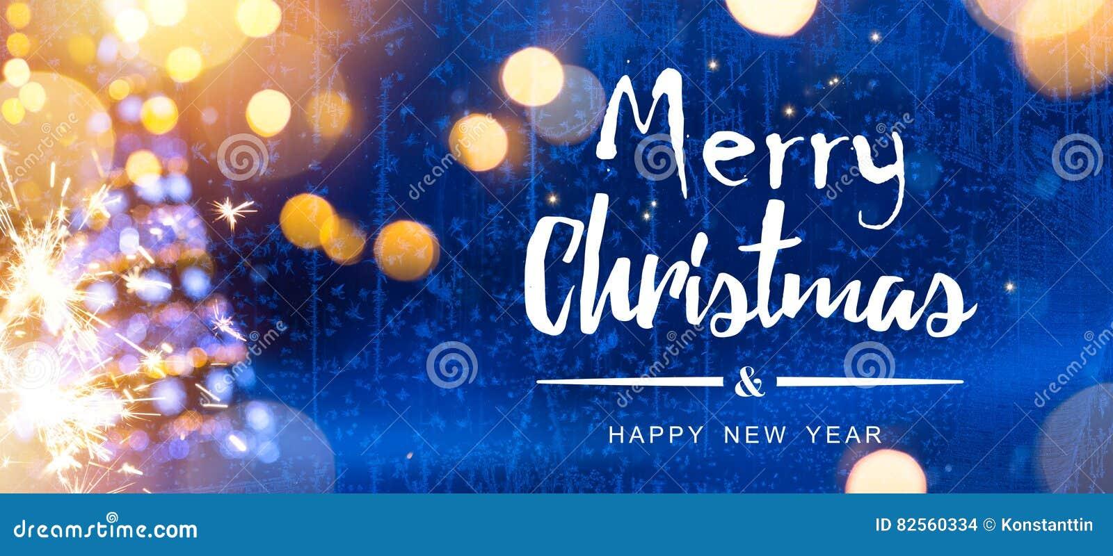 明亮的圣诞节;与树的蓝色Xmas假日背景