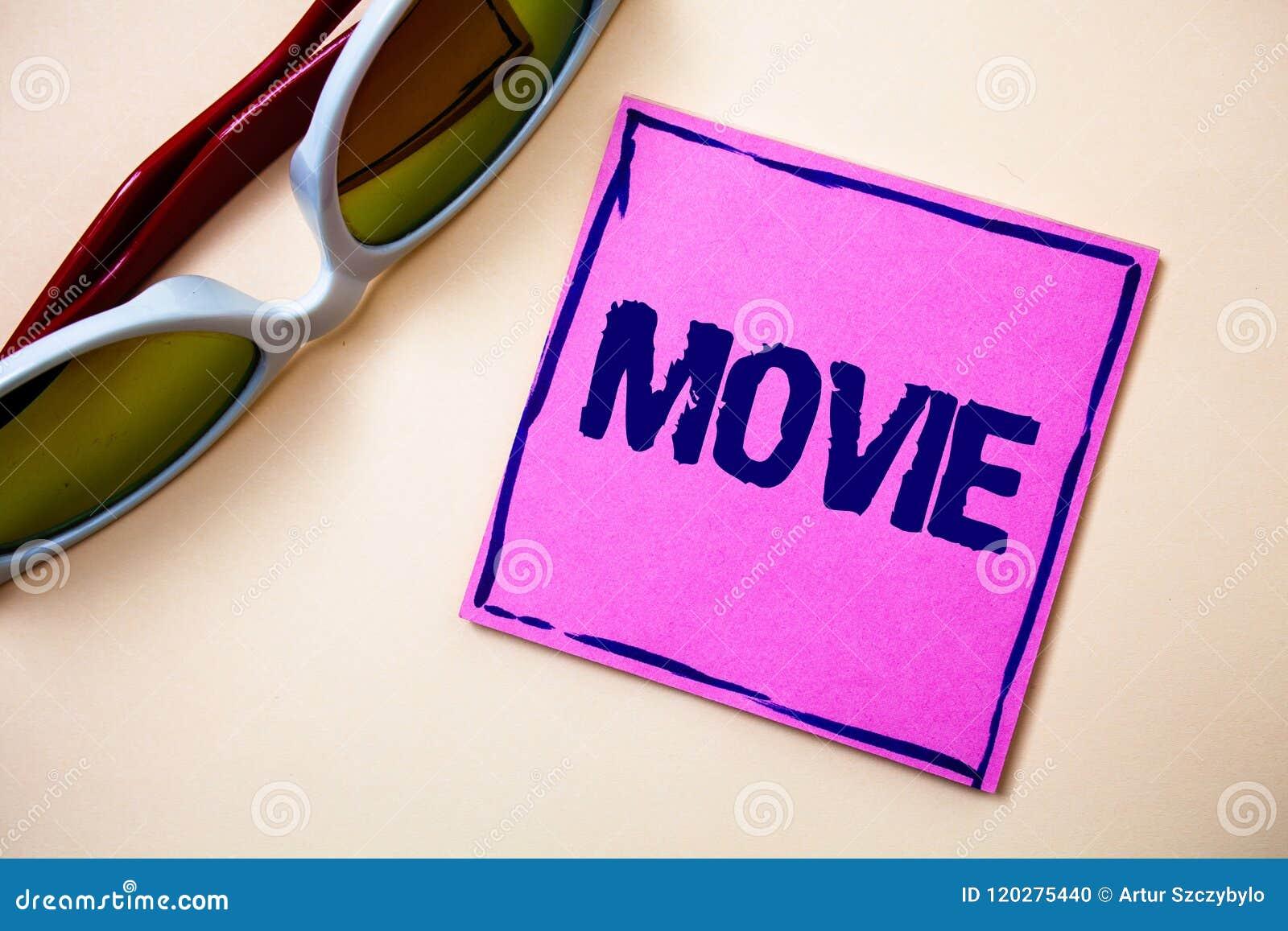 显示电影的概念性手文字 企业照片文本戏院或在屏幕显示的电视影片电影录影Stic上