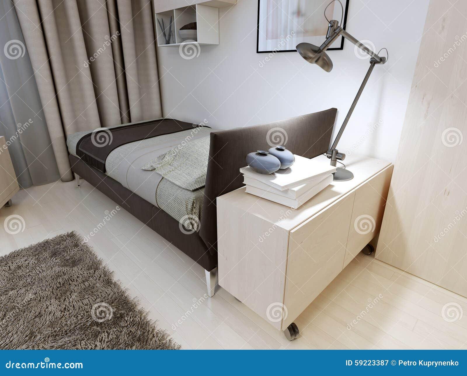 有严密的家具的卧室 与毯子和枕头,床头柜,金属灯,羊毛地毯的软的黑图片