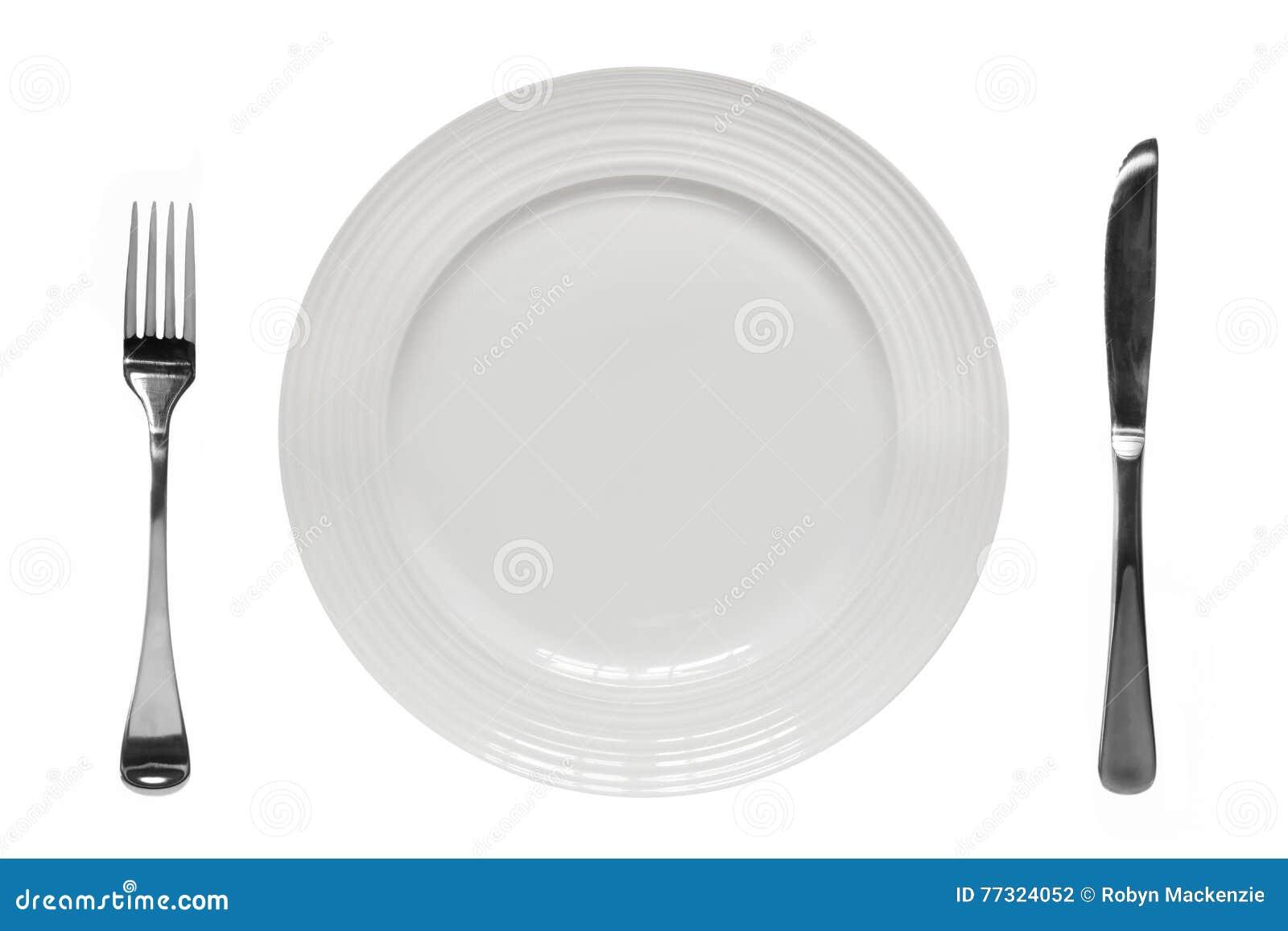 有刀子和叉子顶视图被隔绝的空的板材