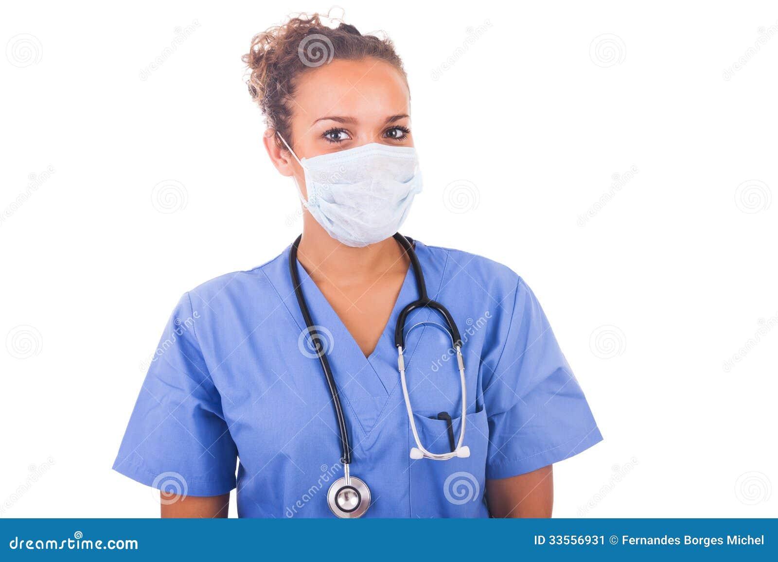 有在白色backgro和听诊器的年轻医生隔绝的面具