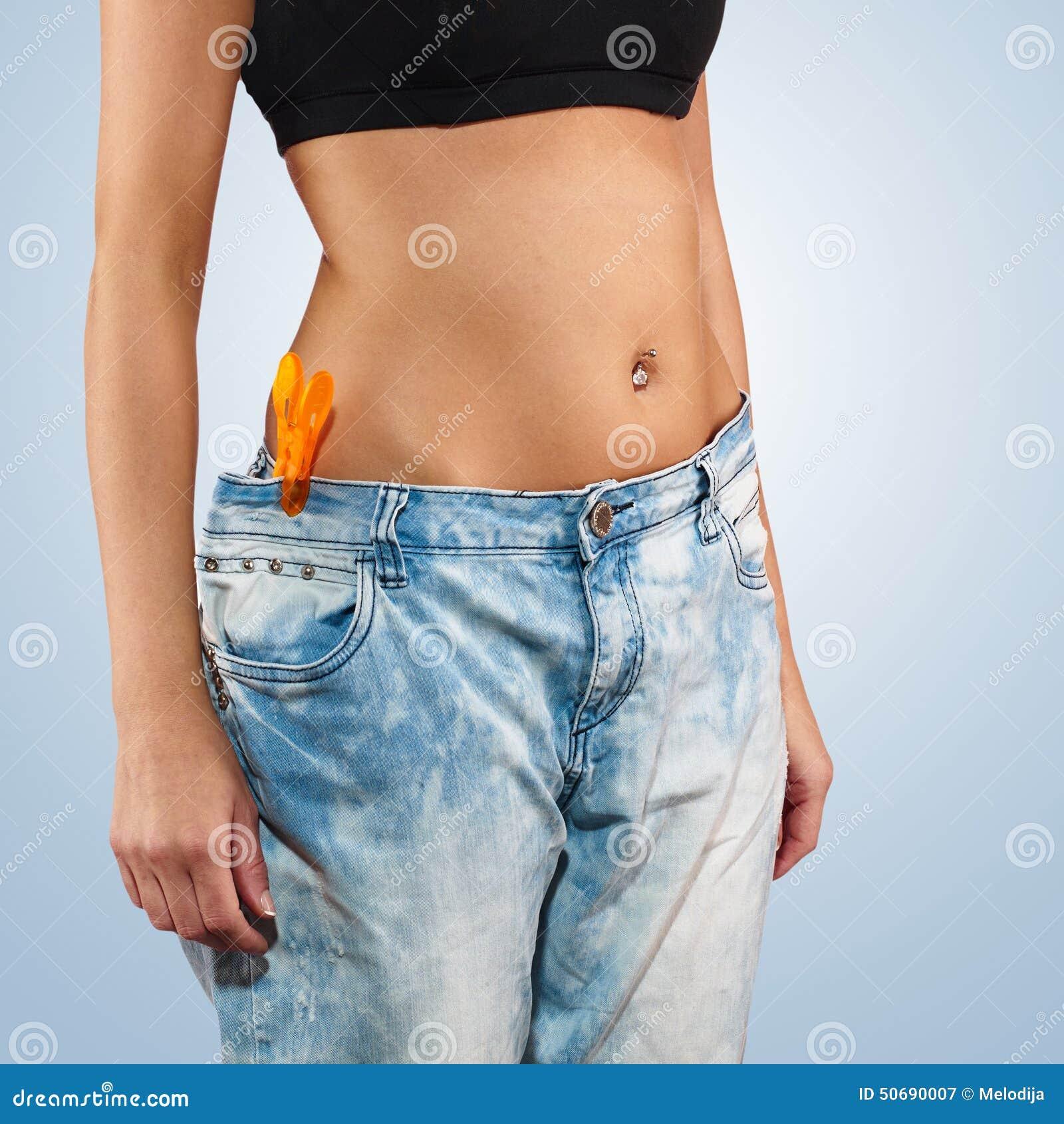 Download 有大牛仔裤减重的妇女 库存图片. 图片 包括有 健康, 背包, 丢失, 女孩, 爱好健美者, 突出, 复制 - 50690007