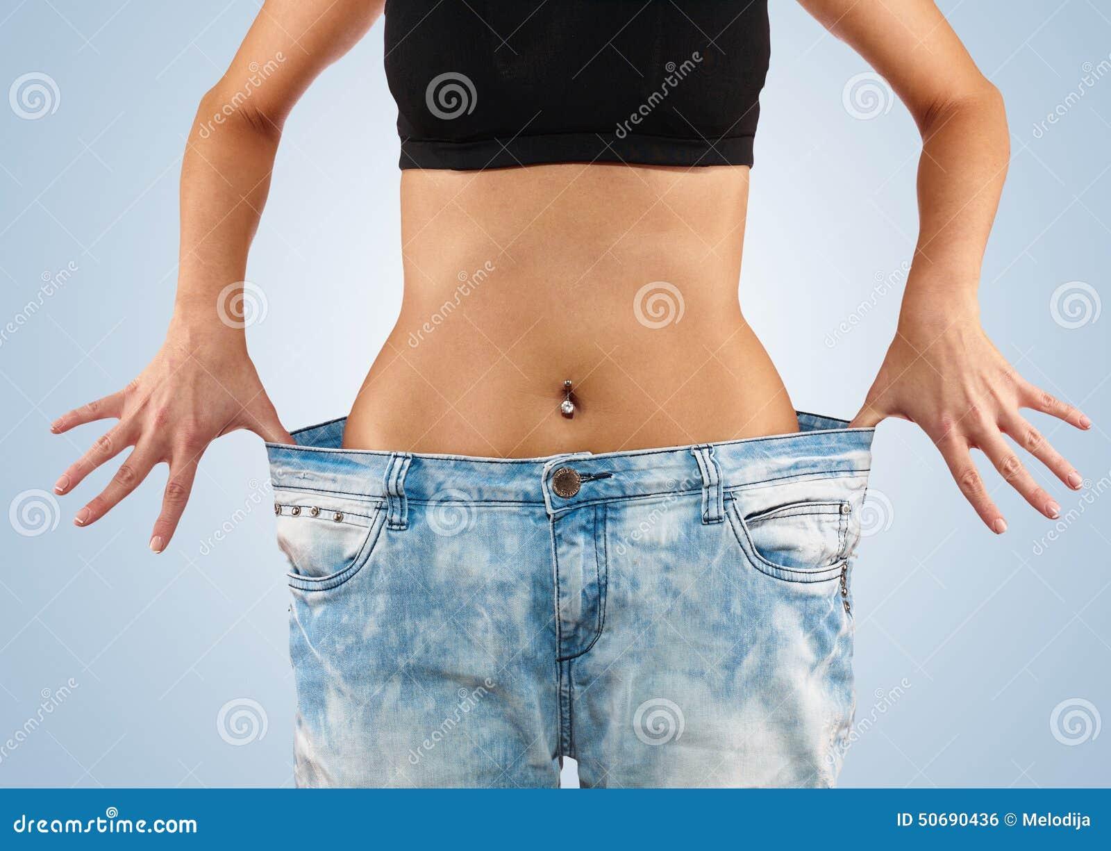 Download 有大牛仔裤减重的妇女 库存照片. 图片 包括有 相当, beauvoir, 炫耀, 背包, 爱好健美者, 失去 - 50690436