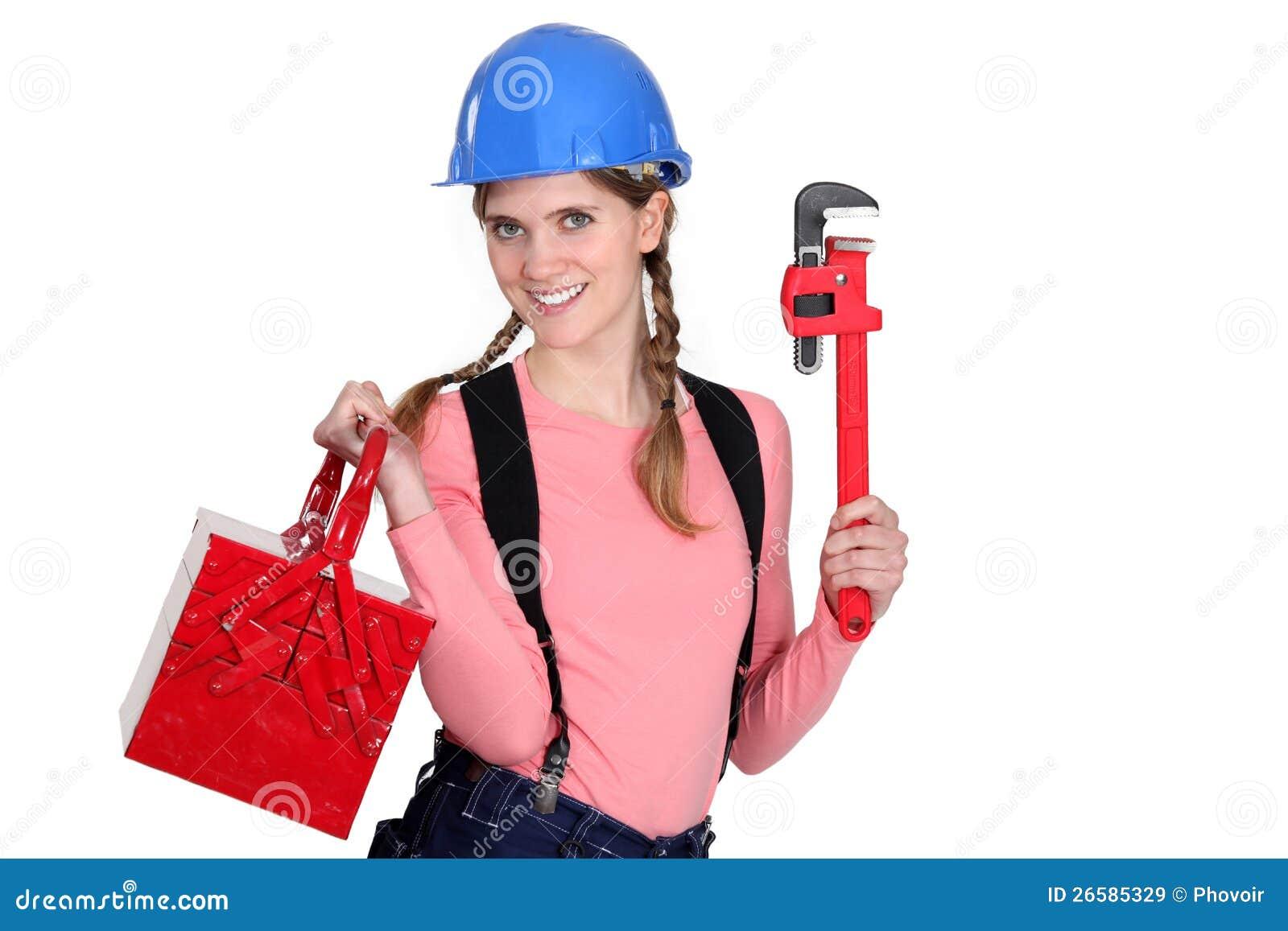 有工具箱的女性工作者。