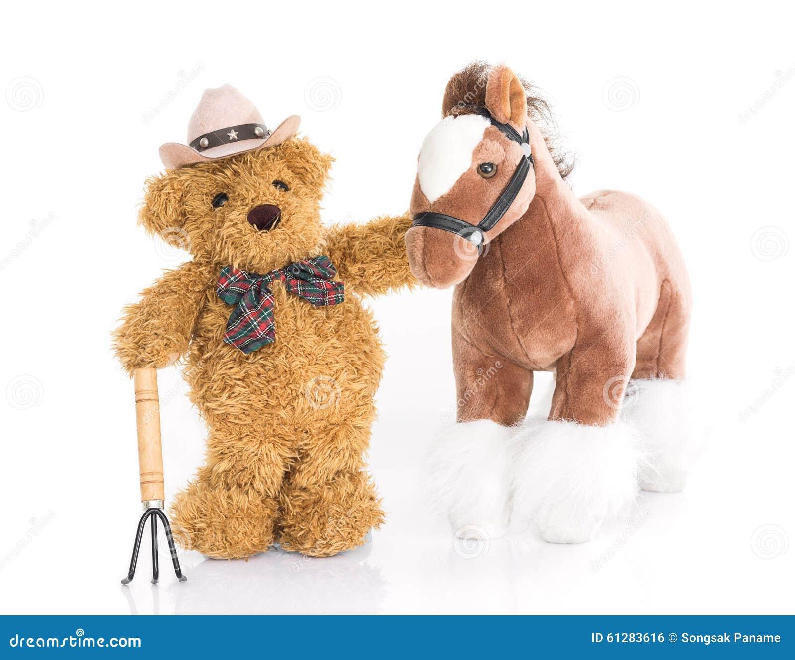 白色农夫网站_玩具熊 有干草叉和马的农夫在白色背景.